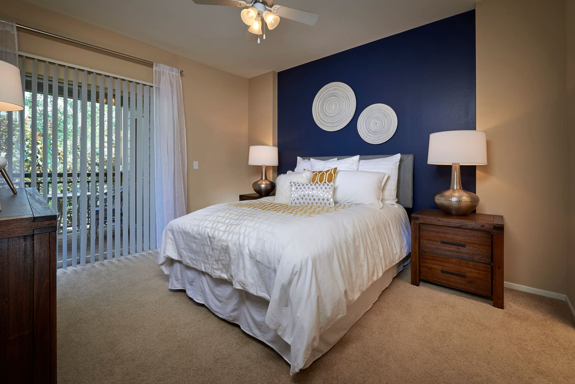 Master bedroom with a ceiling fan at Legend Oaks Apartments in Aurora, Colorado
