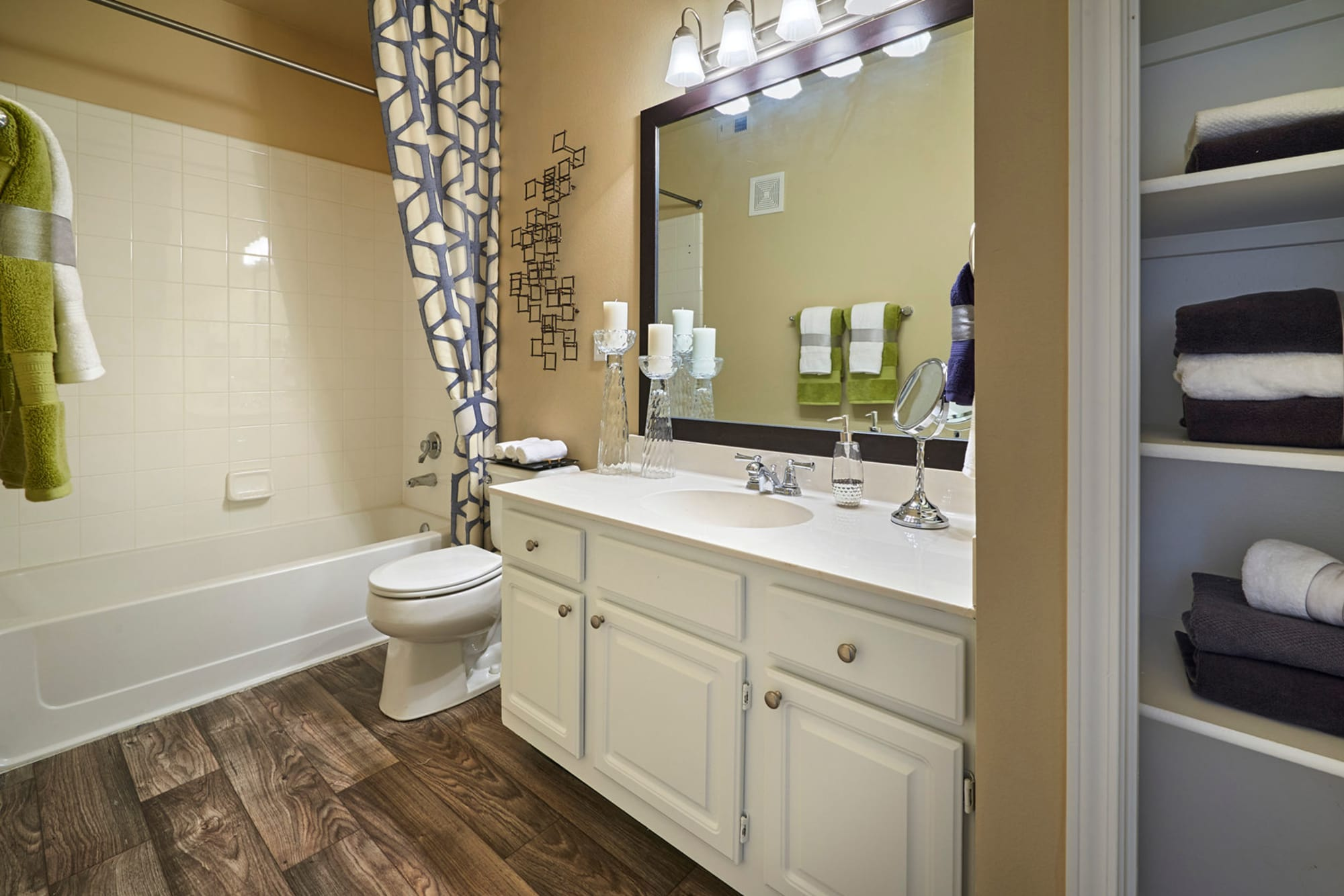 Bathroom with a large vanity mirror at Legend Oaks Apartments in Aurora, Colorado