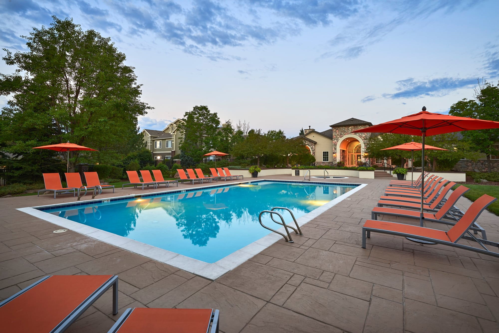 Pool area with lounge chairs at Legend Oaks Apartments