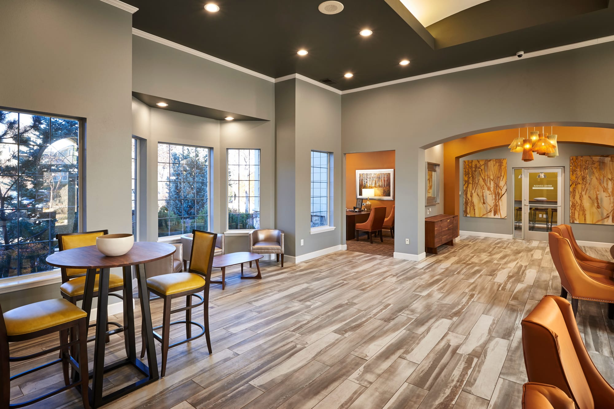 Contemporary clubhouse with wood-style flooring at Legend Oaks Apartments in Aurora, Colorado