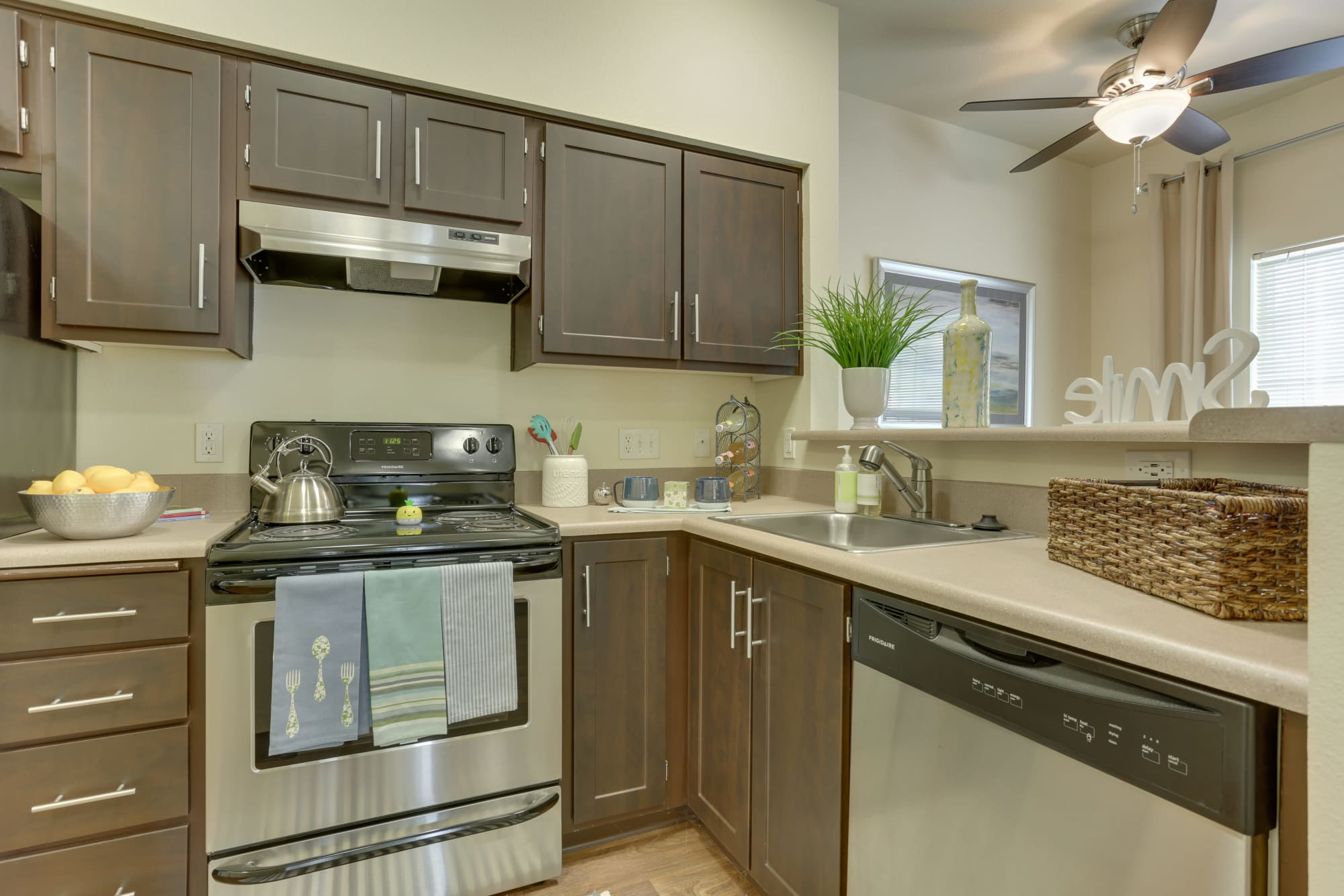 newly renovated brown renovated kitchen with stainless steel appliances At The Landings at Morrison Apartments