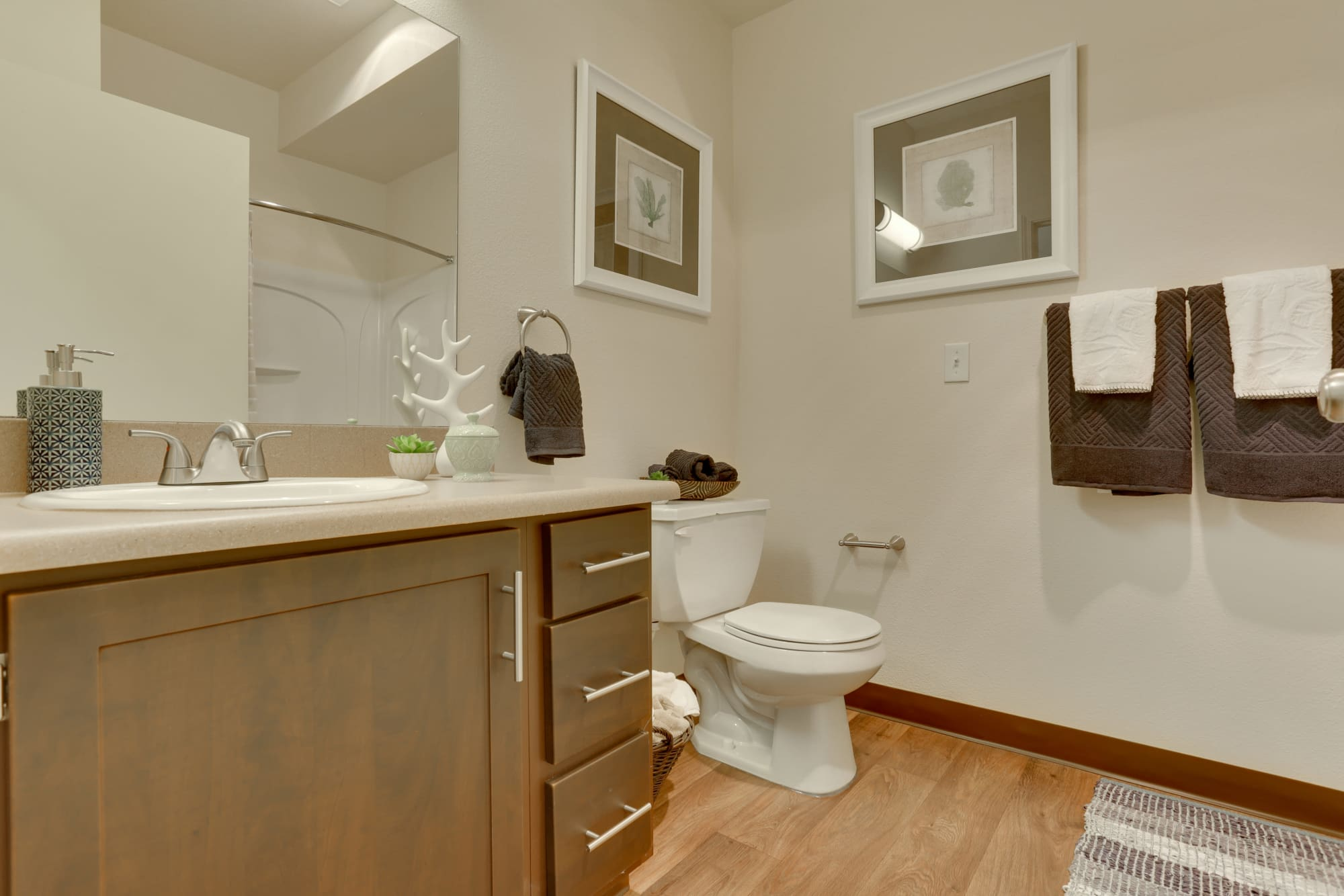 brown renovated bathroom in a model home At The Landings at Morrison Apartments