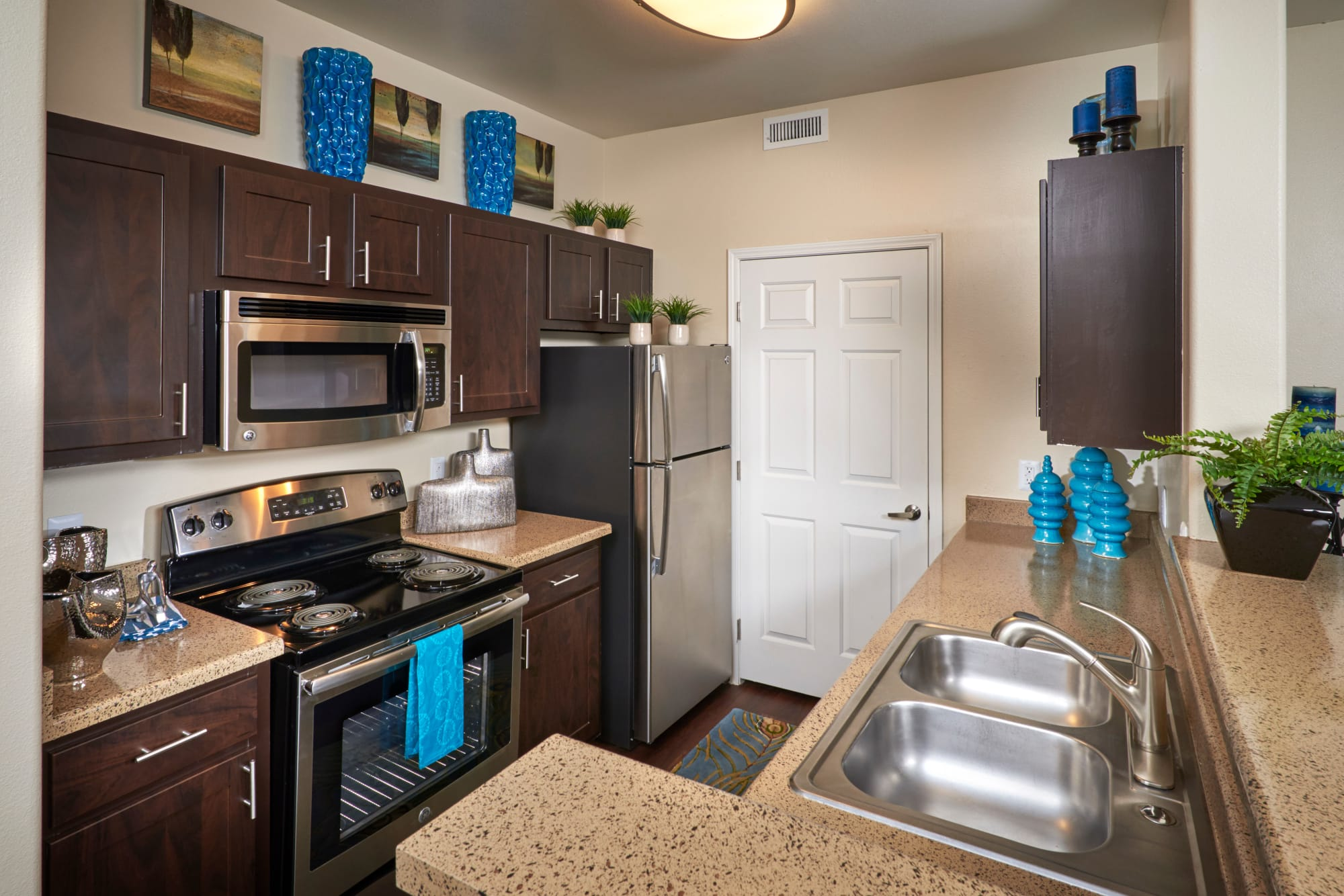 Well organized, renovated kitchen at Promenade at Hunter's Glen Apartments in Thornton, Colorado