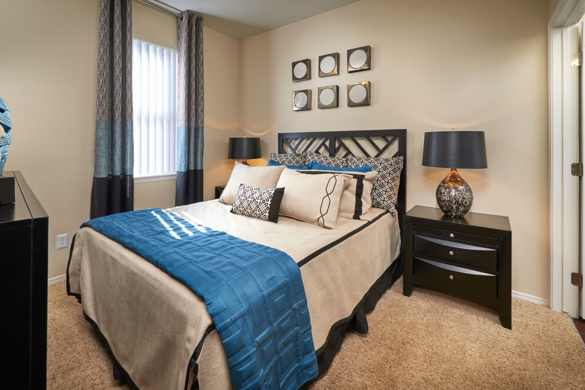 Comfortable bedroom at Promenade at Hunter's Glen Apartments in Thornton, Colorado