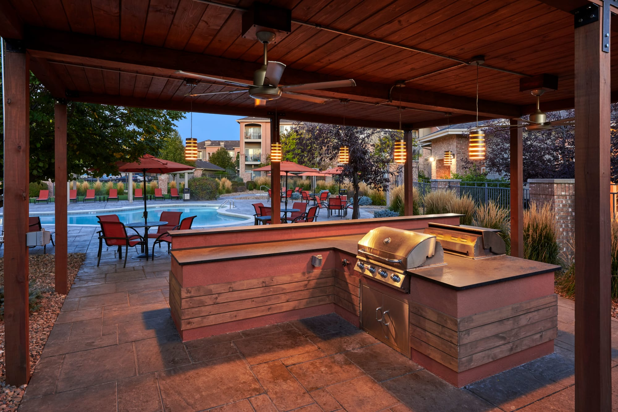 outdoor covered poolside BBQ at Hawthorne Hill Apartments