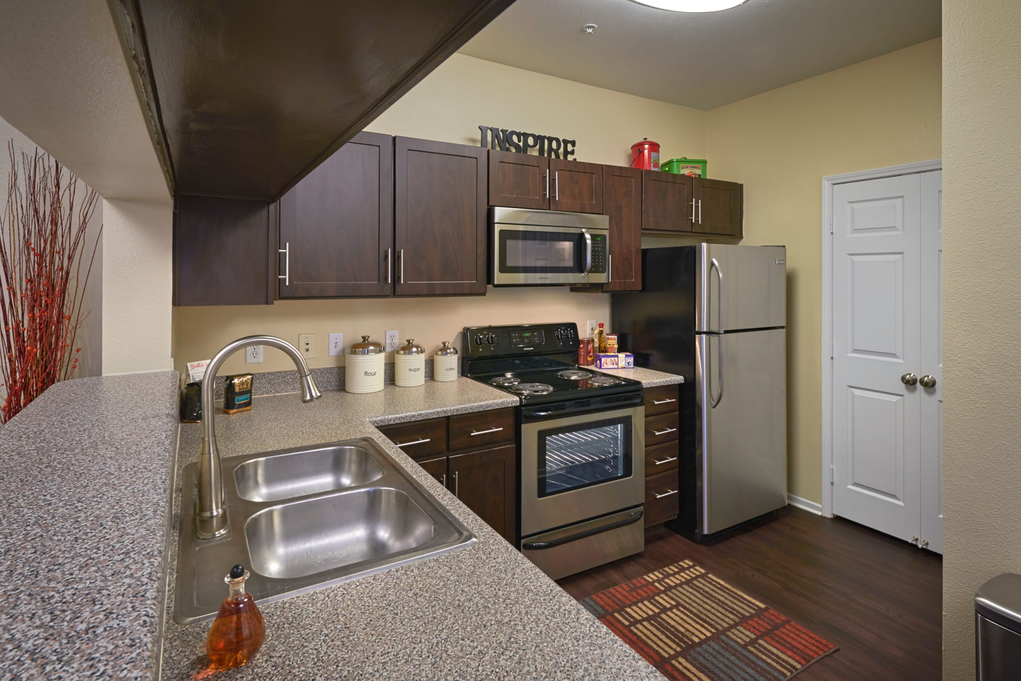 Fully equipped renovated brown Kitchen with stainless steel appliances At Hawthorne Hill Apartments