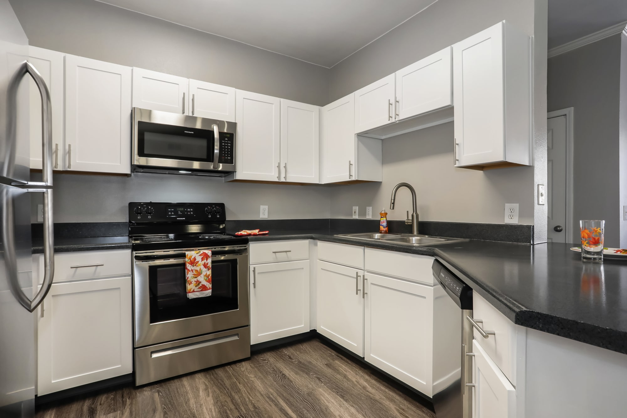 White Renovation Kitchen  with stainless steel appliances Hawthorne Hill Apartments