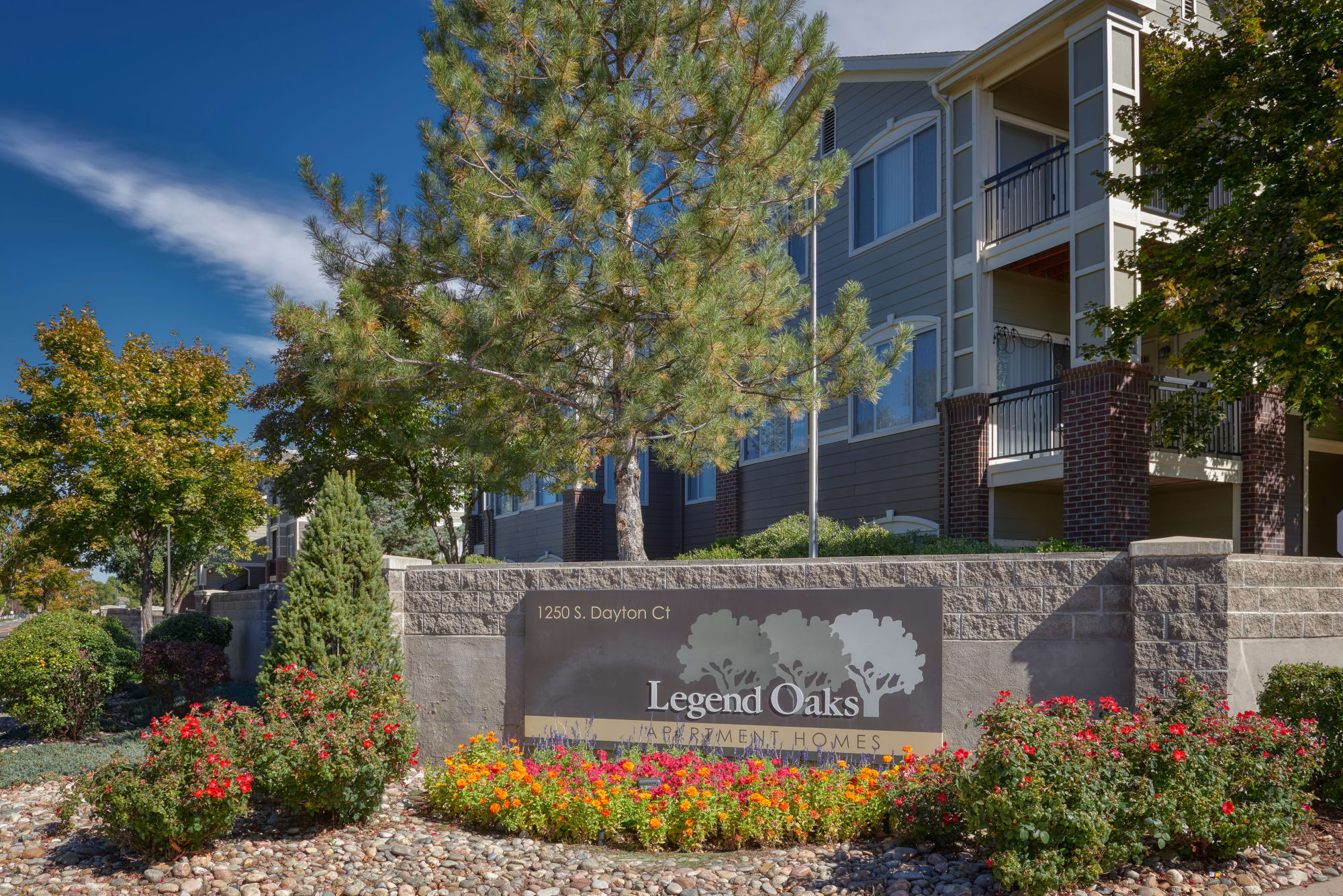 monument sign and lush landscaping view at Legend Oaks Apartments