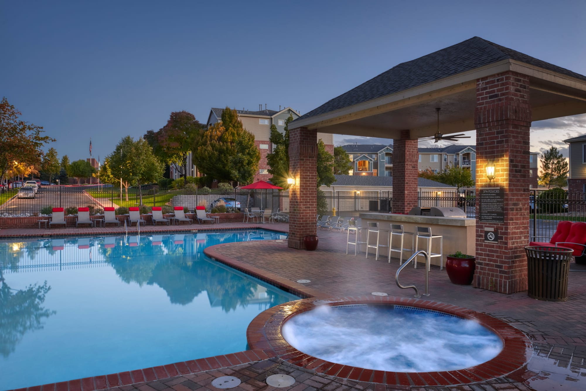 Bubbling spa and pool at sunrise at Promenade at Hunter's Glen Apartments in Thornton, Colorado