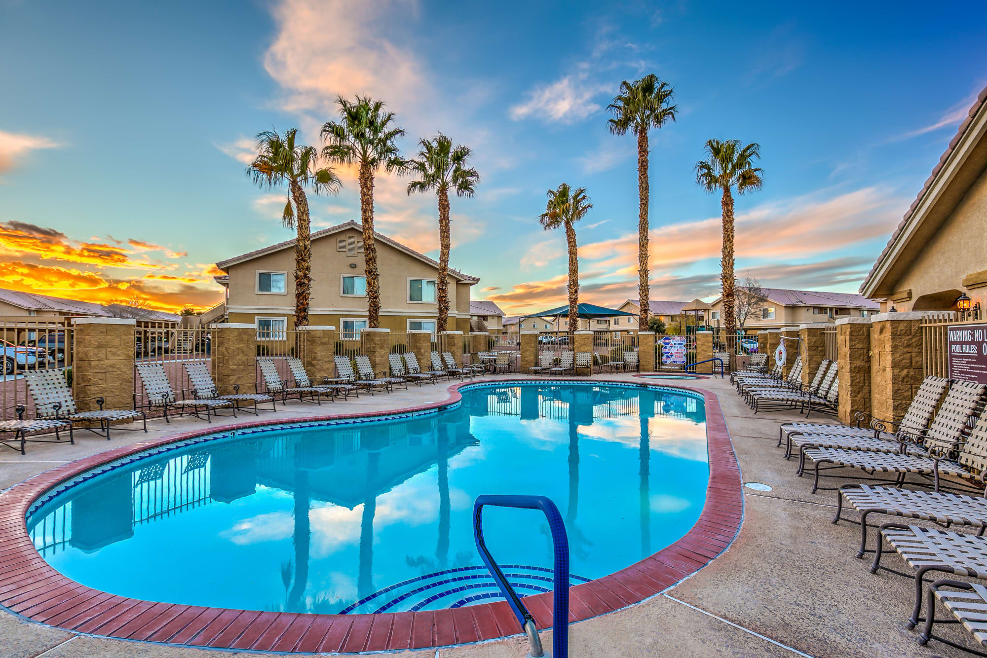 Gorgeous swimming pool area with lounge chairs at Portola Del Sol in Las Vegas