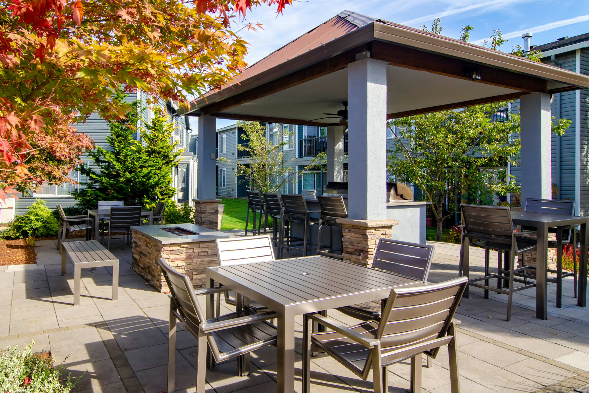 Fire pit and barbecue area at The Addison Apartments in Vancouver, Washington