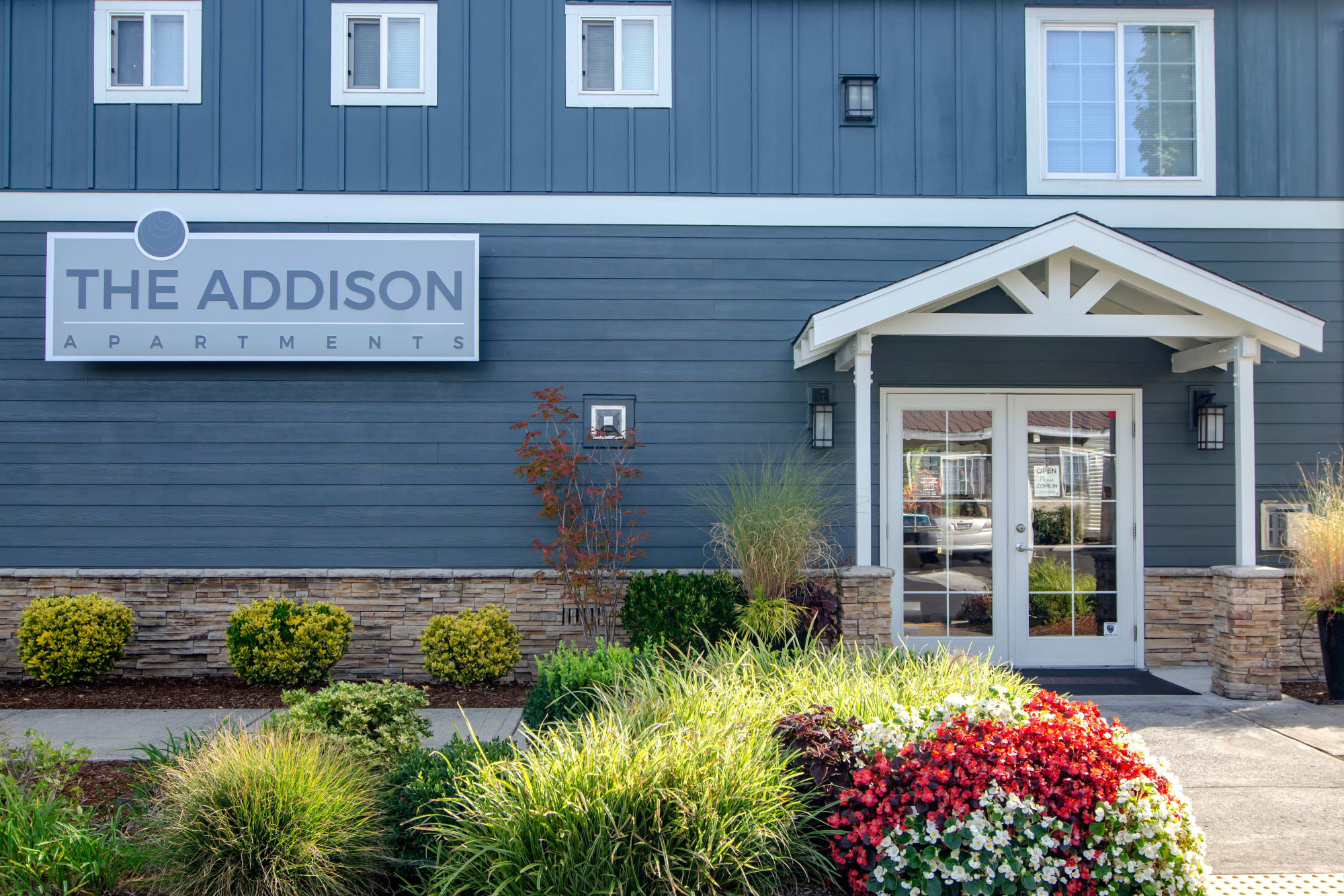 Exterior of the leasing office at The Addison Apartments in Vancouver, Washington