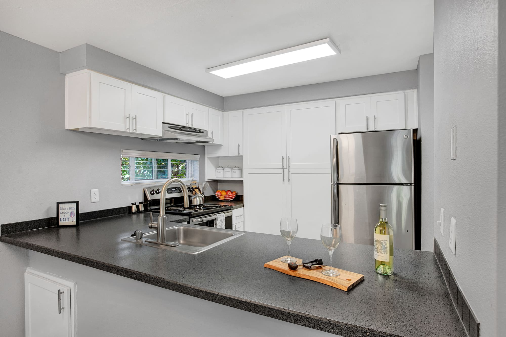 Kitchen with a breakfast bar at Park South Apartments in Seattle, Washington