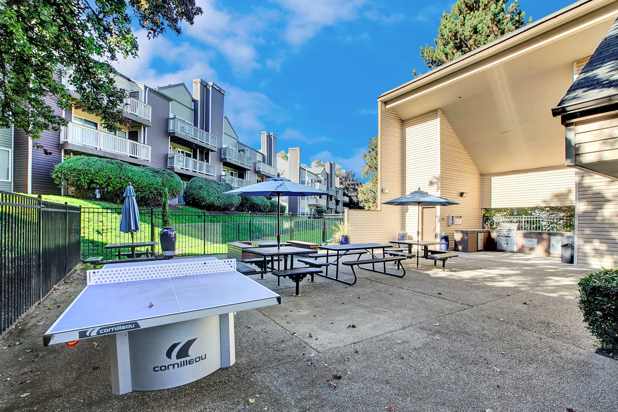 Ping pong table and barbecue area at Park South Apartments in Seattle, Washington