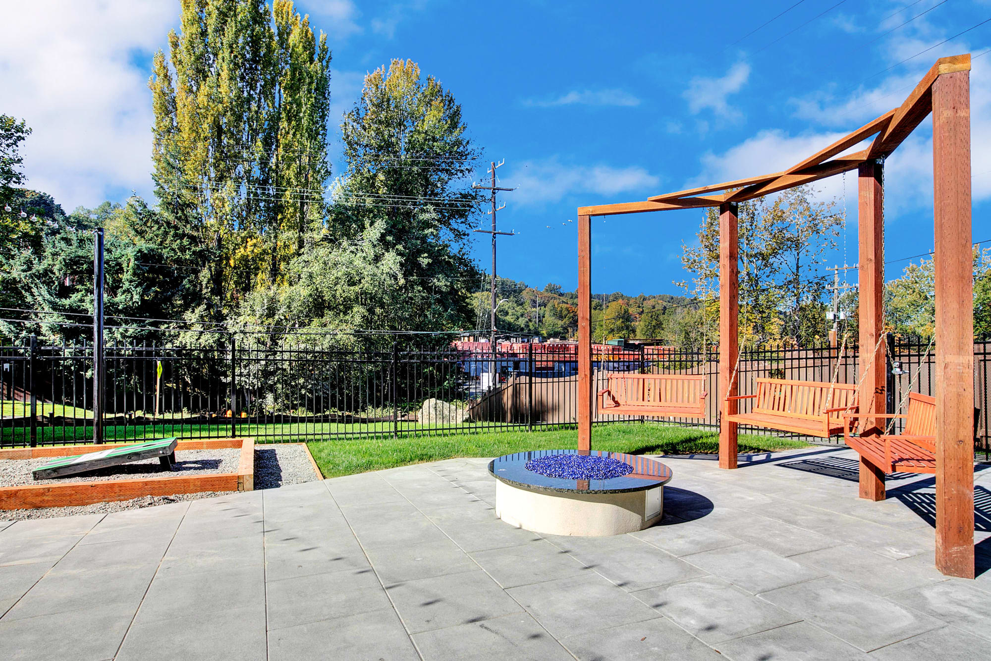 Corn hole courts near the fire pit lounge area at Park South Apartments in Seattle, Washington
