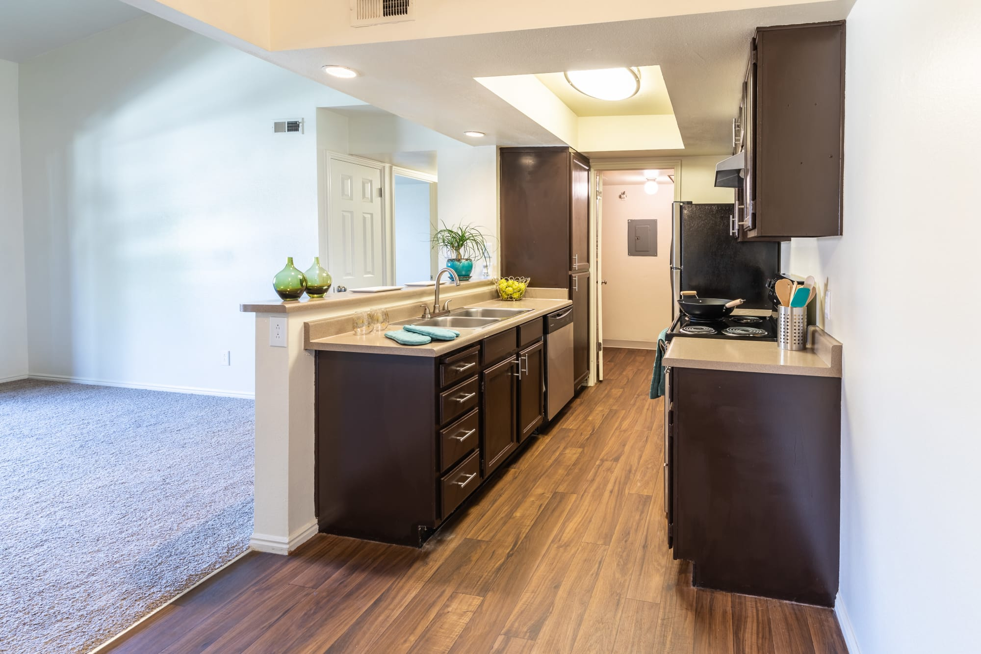 Spacious Kitchen Room with View into Living Room at Shadowbrook Apartments in West Valley City, UT