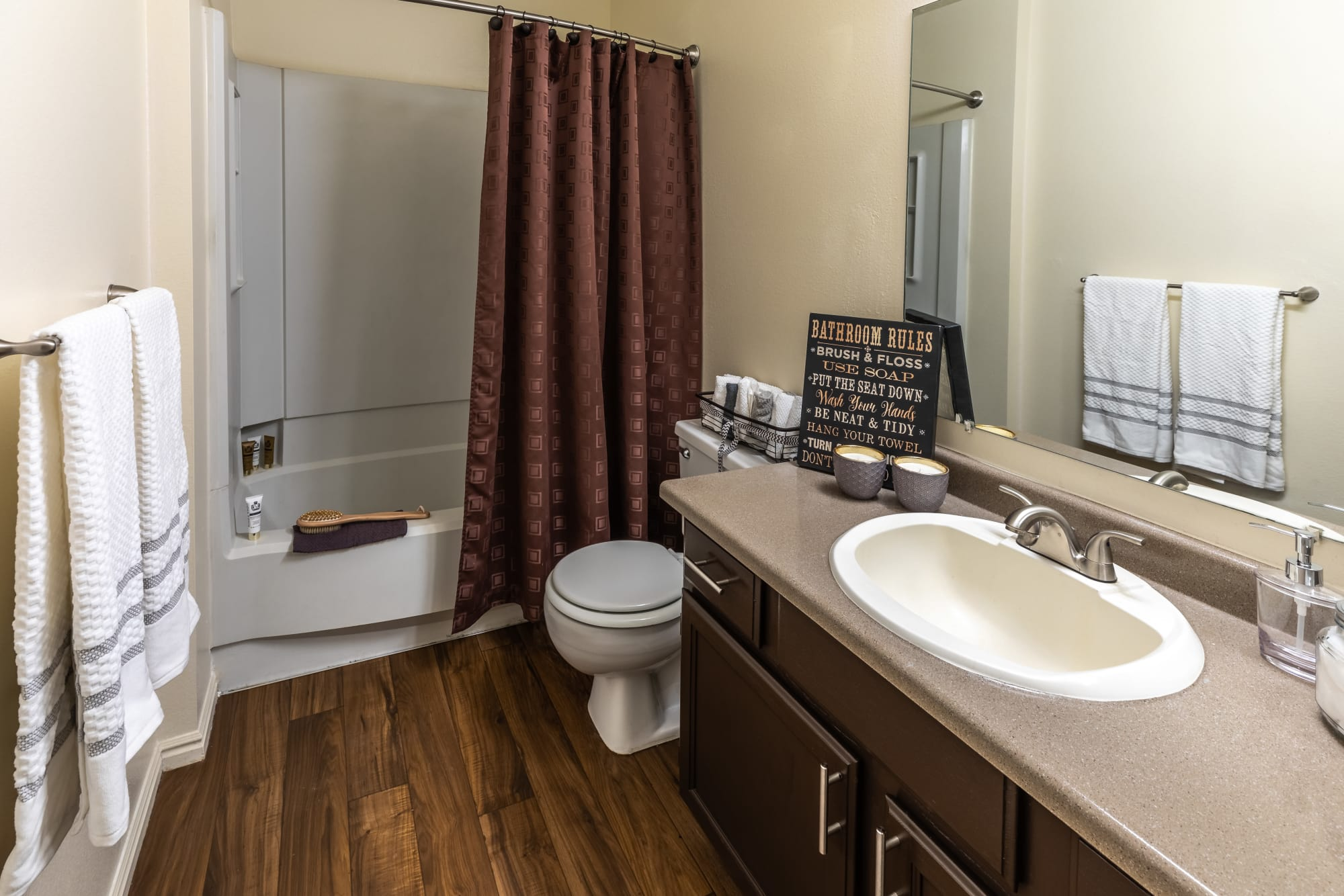 Hardwood flooring in a bathroom at Shadowbrook Apartments in West Valley City, Utah