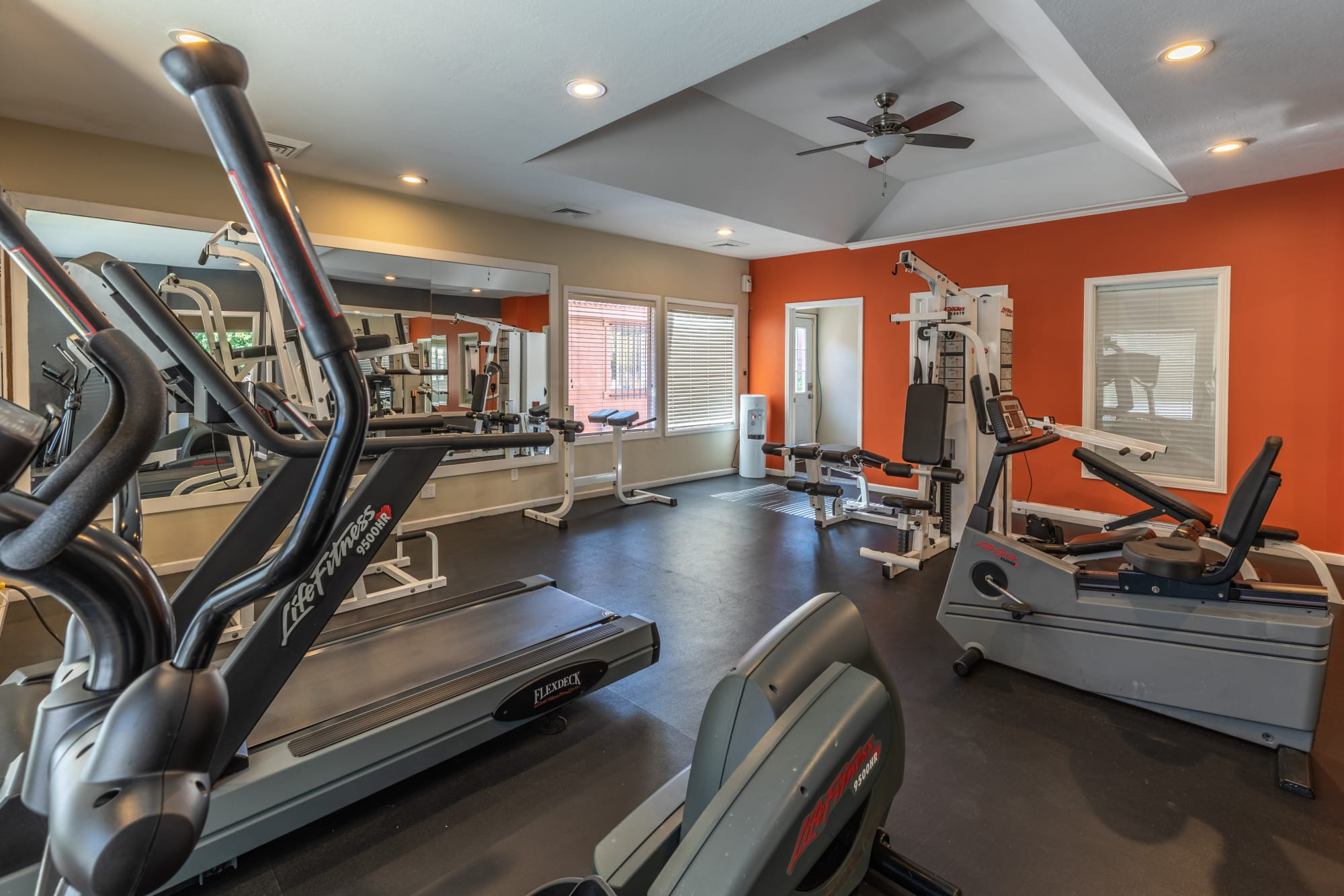 Fitness center with cardio machines at Shadowbrook Apartments in West Valley City, Utah
