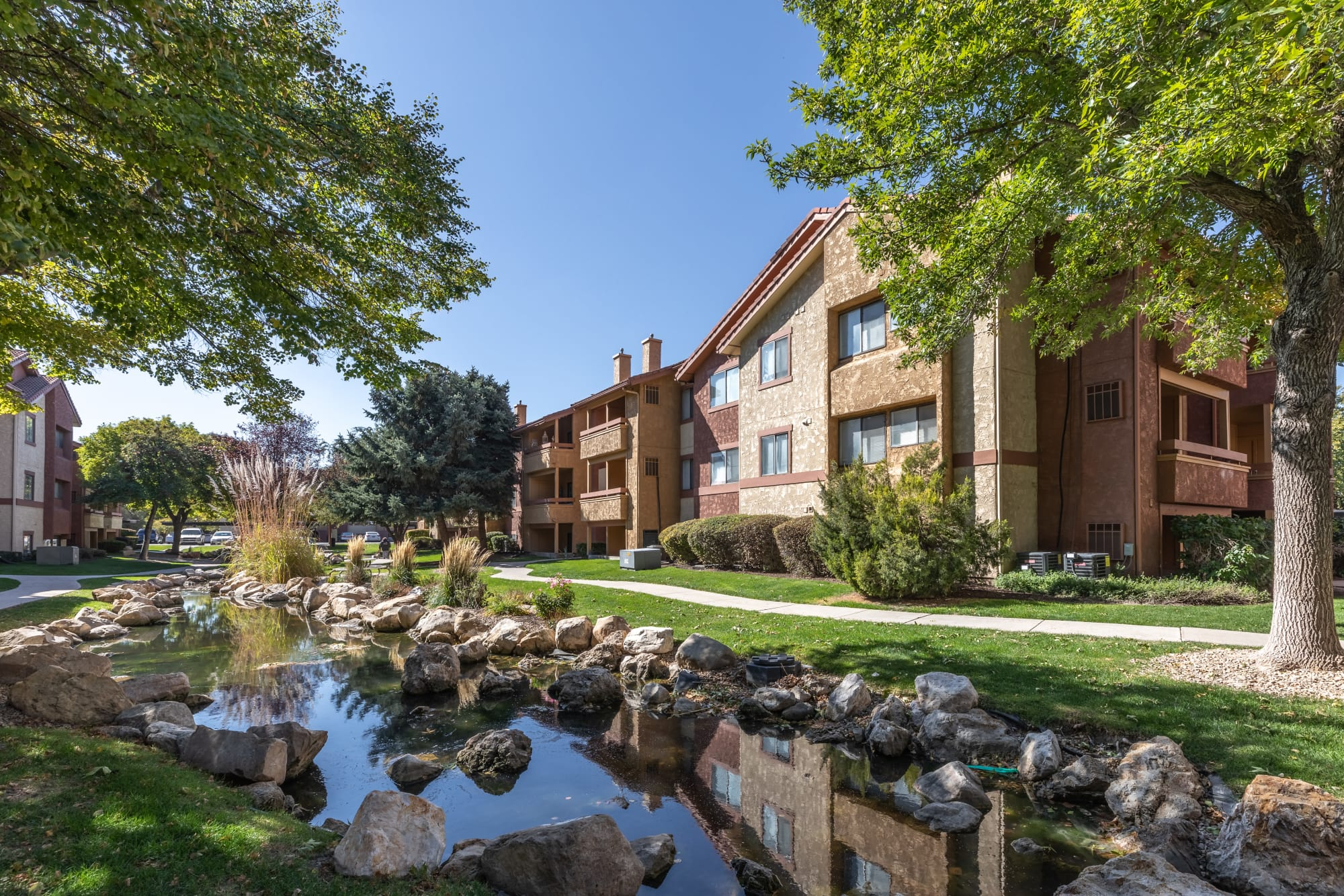 A creek along the property at Shadowbrook Apartments in West Valley City, Utah