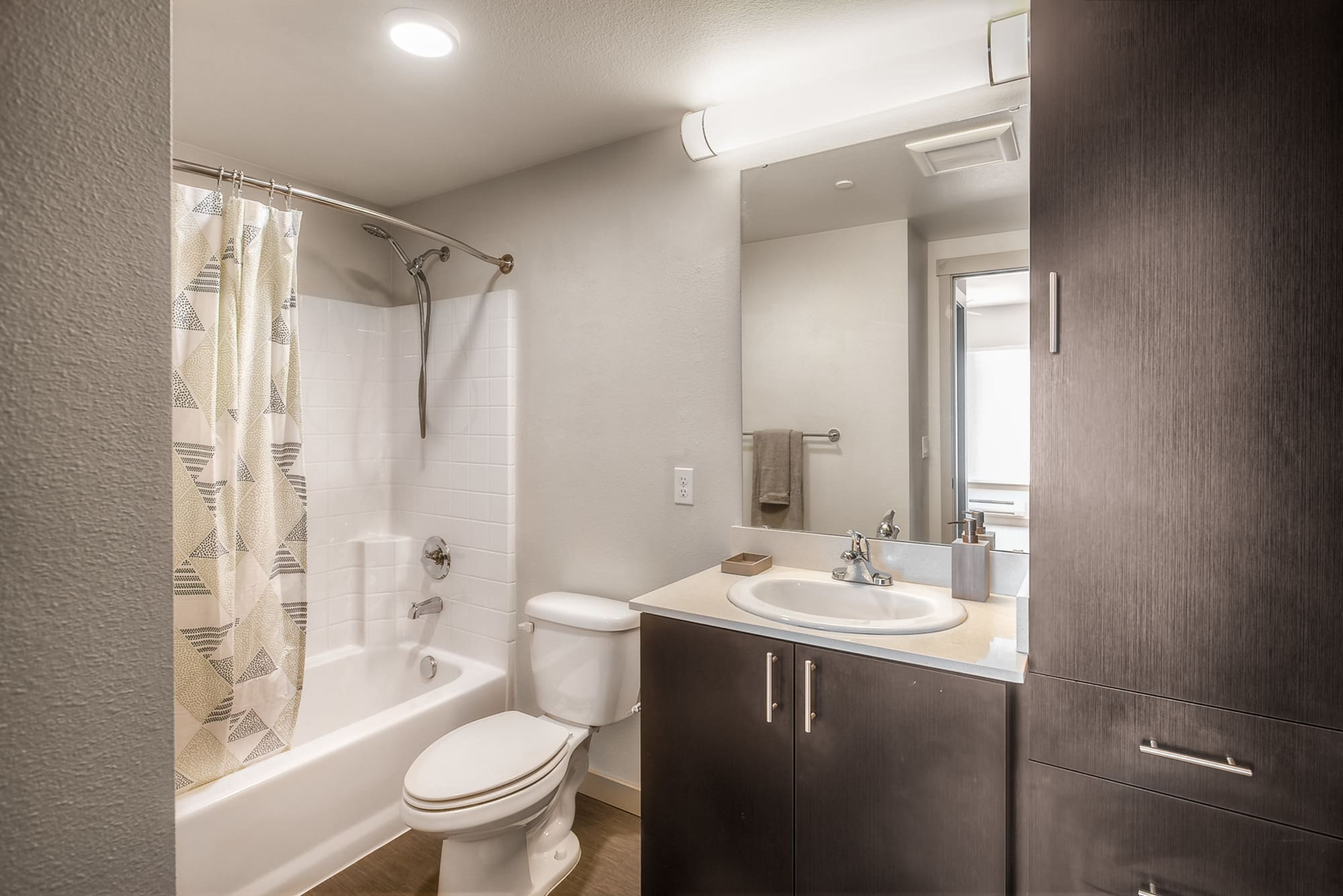 Model bathroom with tub at Tria Apartments in Newcastle