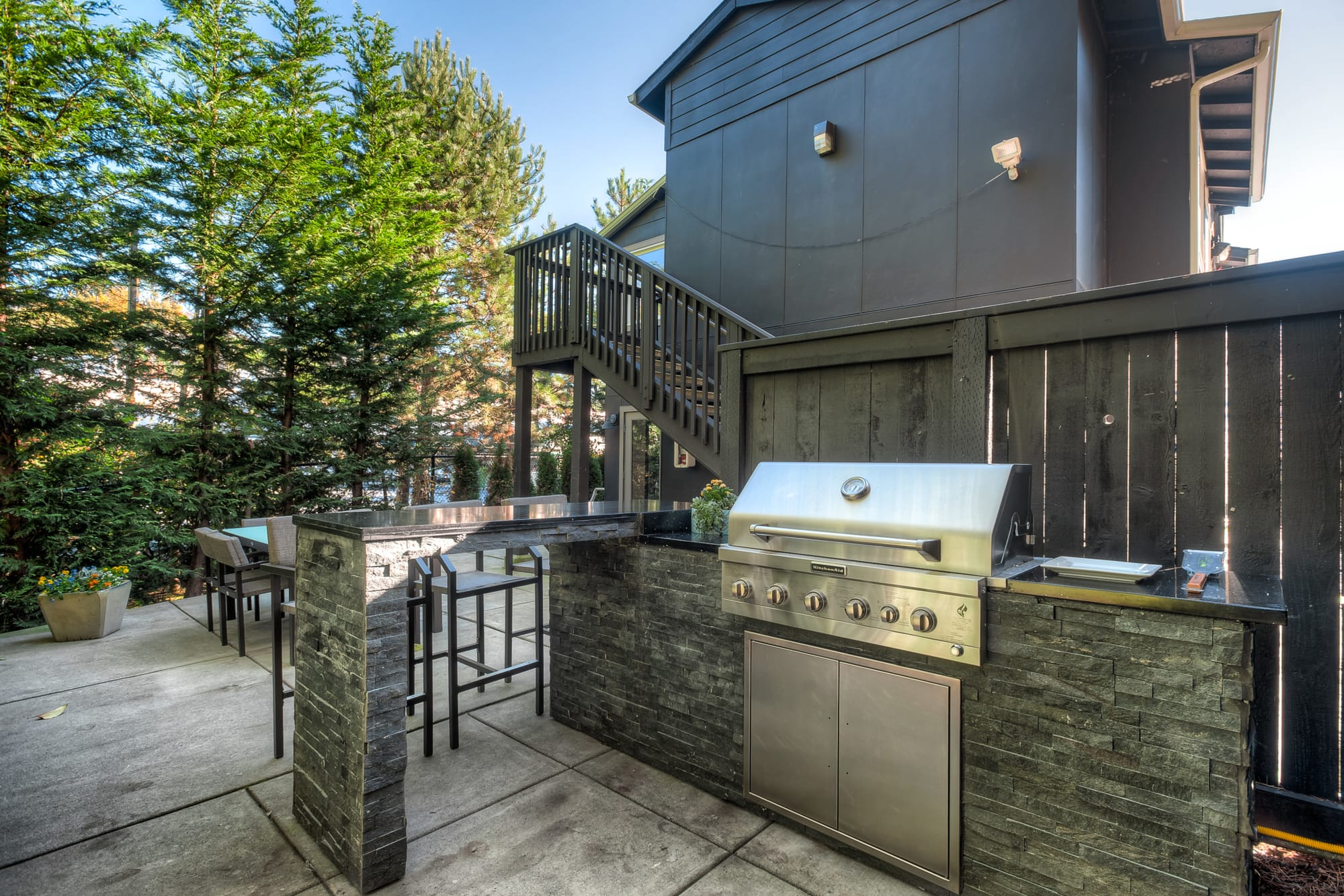 Outdoor BBQ area at Karbon Apartments in Newcastle, Washington