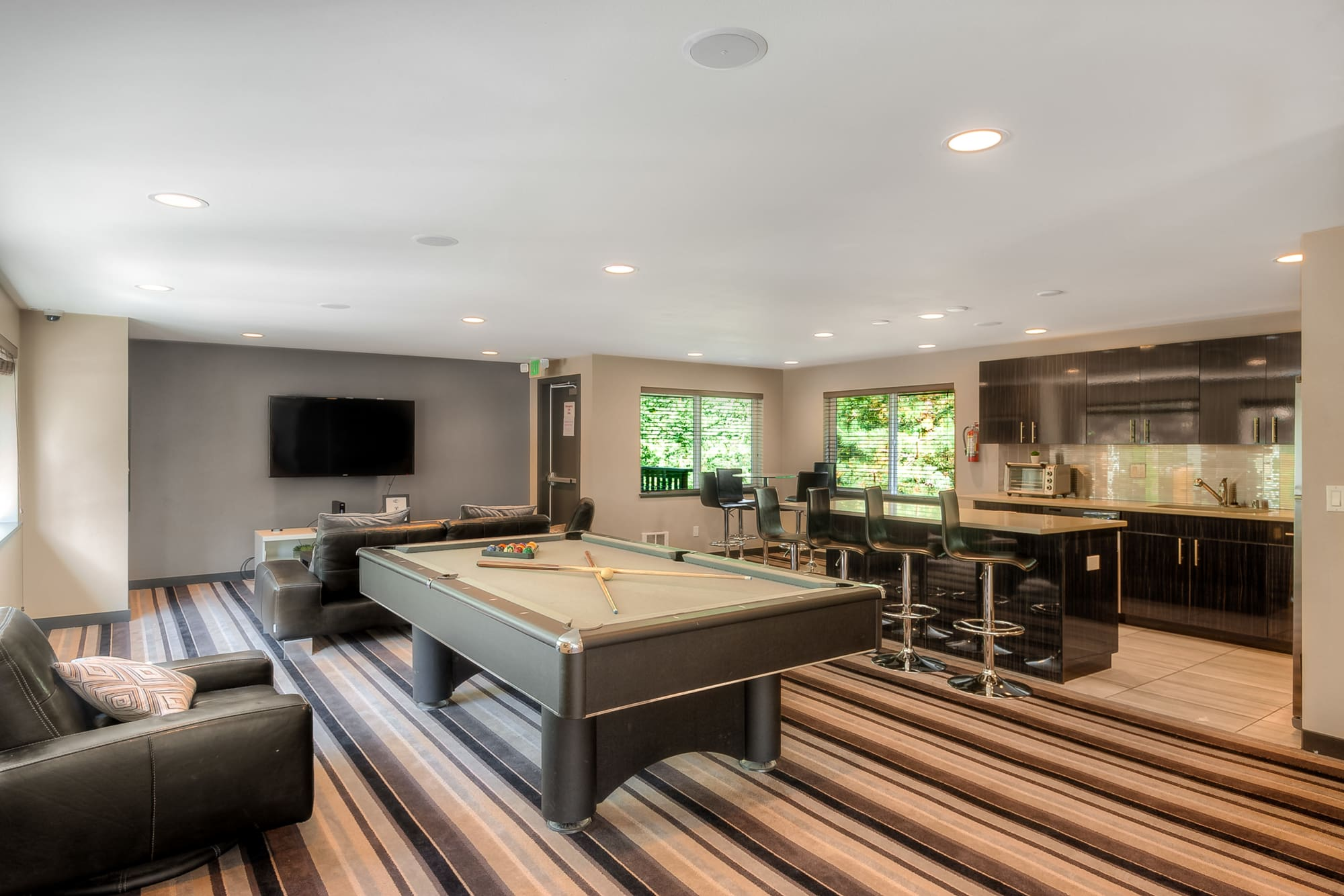 Game room with a pool table at Karbon Apartments in Newcastle, Washington