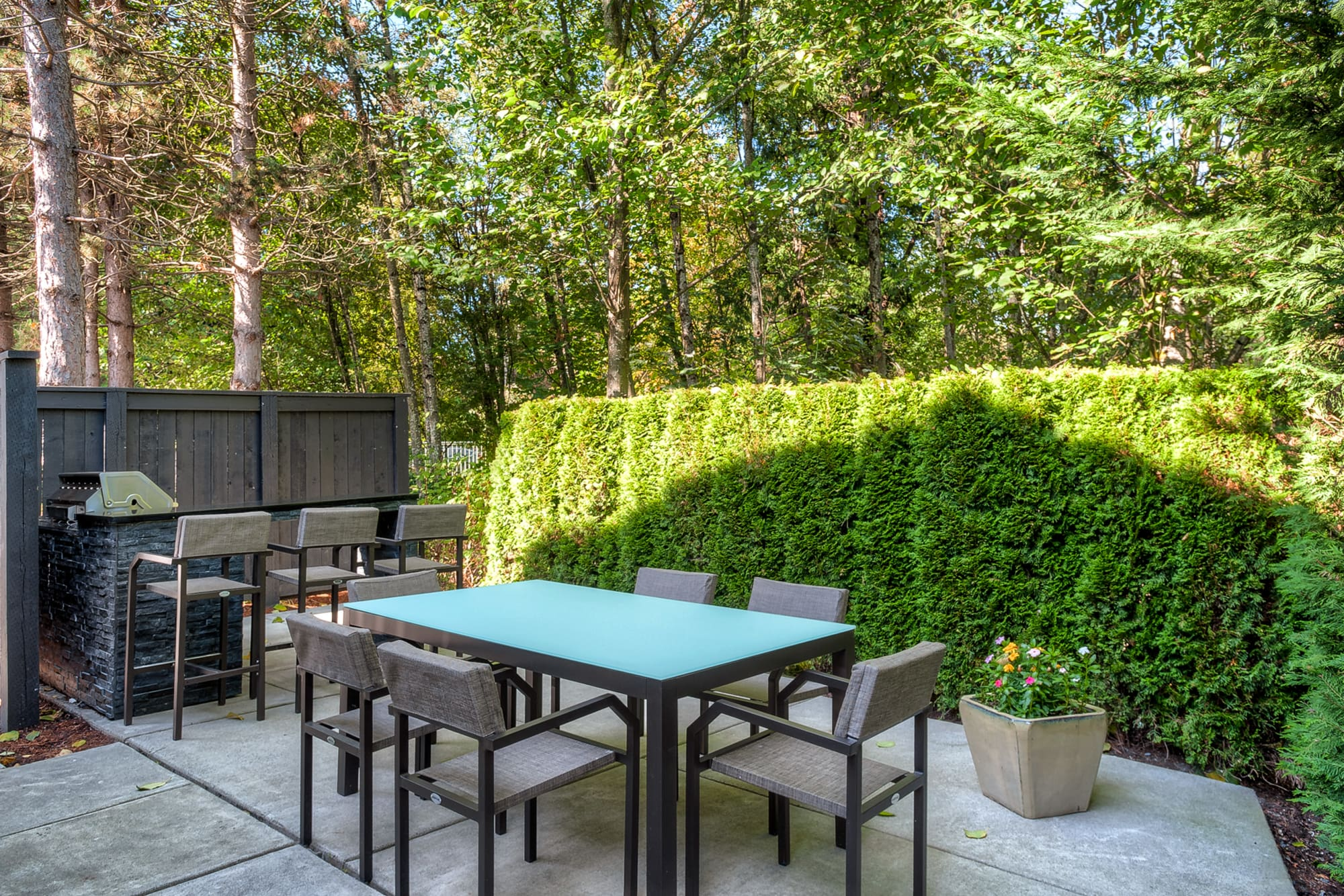 The BBQ lounge area at Karbon Apartments in Newcastle, Washington