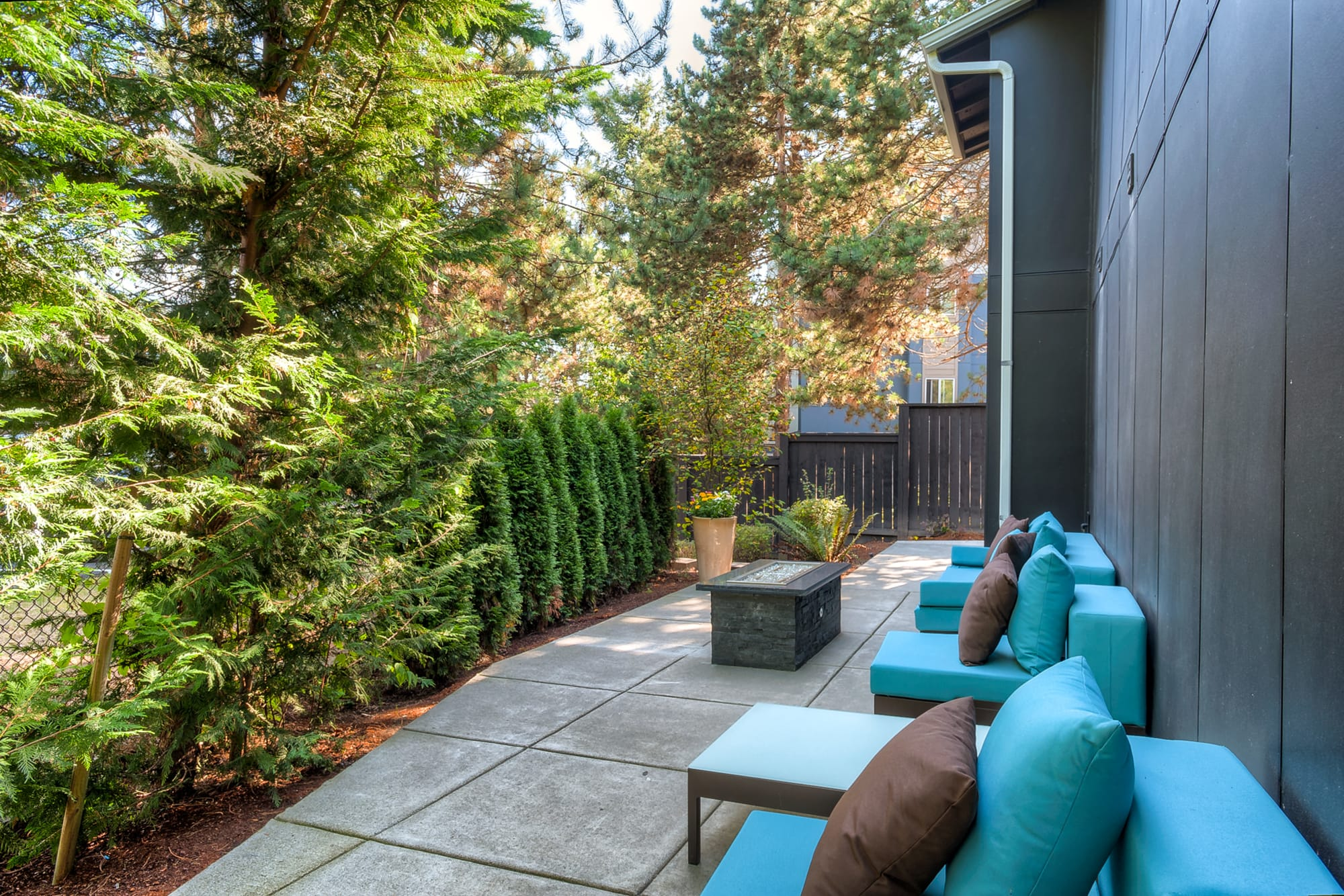 The fire pit lounge area at Karbon Apartments in Newcastle, Washington