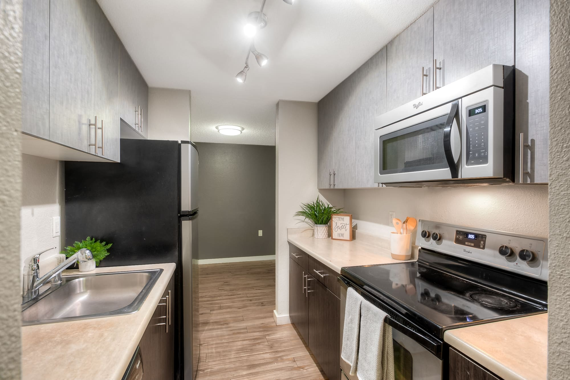 Renovated Kitchen with stainless steel appliances at Karbon Apartments in Newcastle