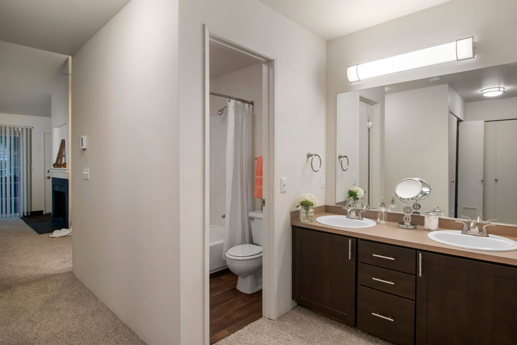 bathroom, brown renovation, view into hallway At Autumn Chase Apartments