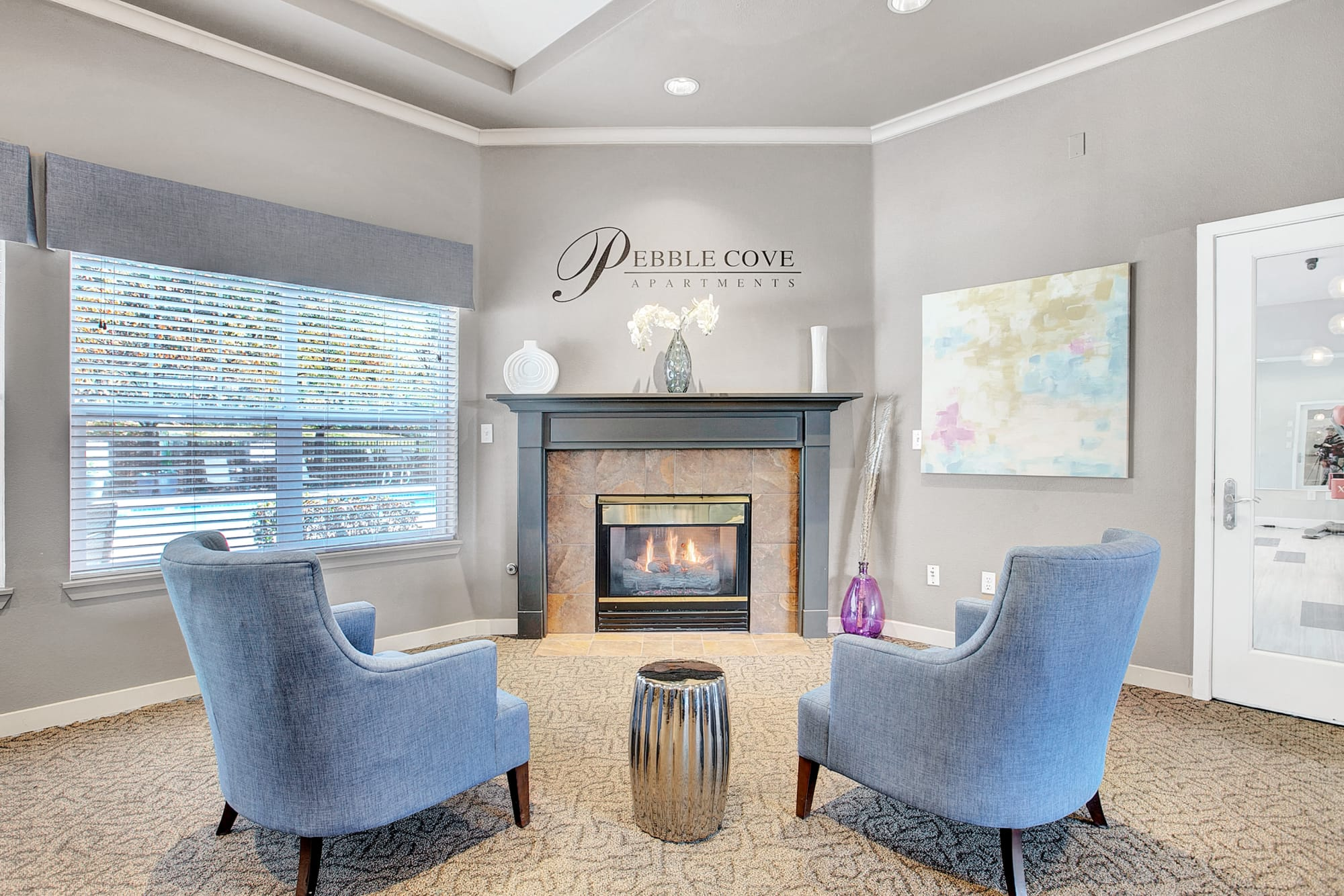 Clubhouse with Fireplace Lounge at Pebble Cove Apartments in Renton