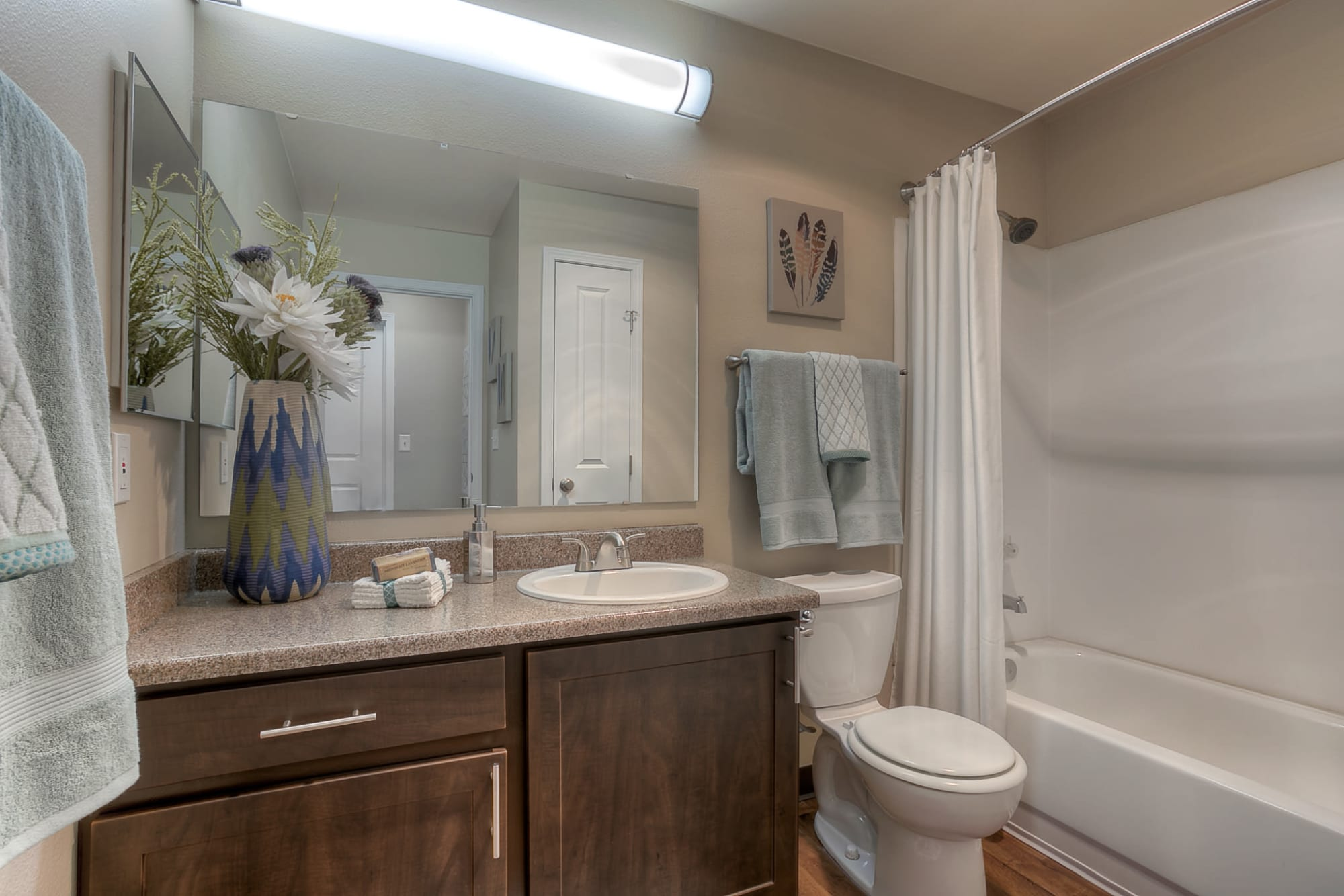 Renovated Bathroom with tub at Pebble Cove Apartments in Renton