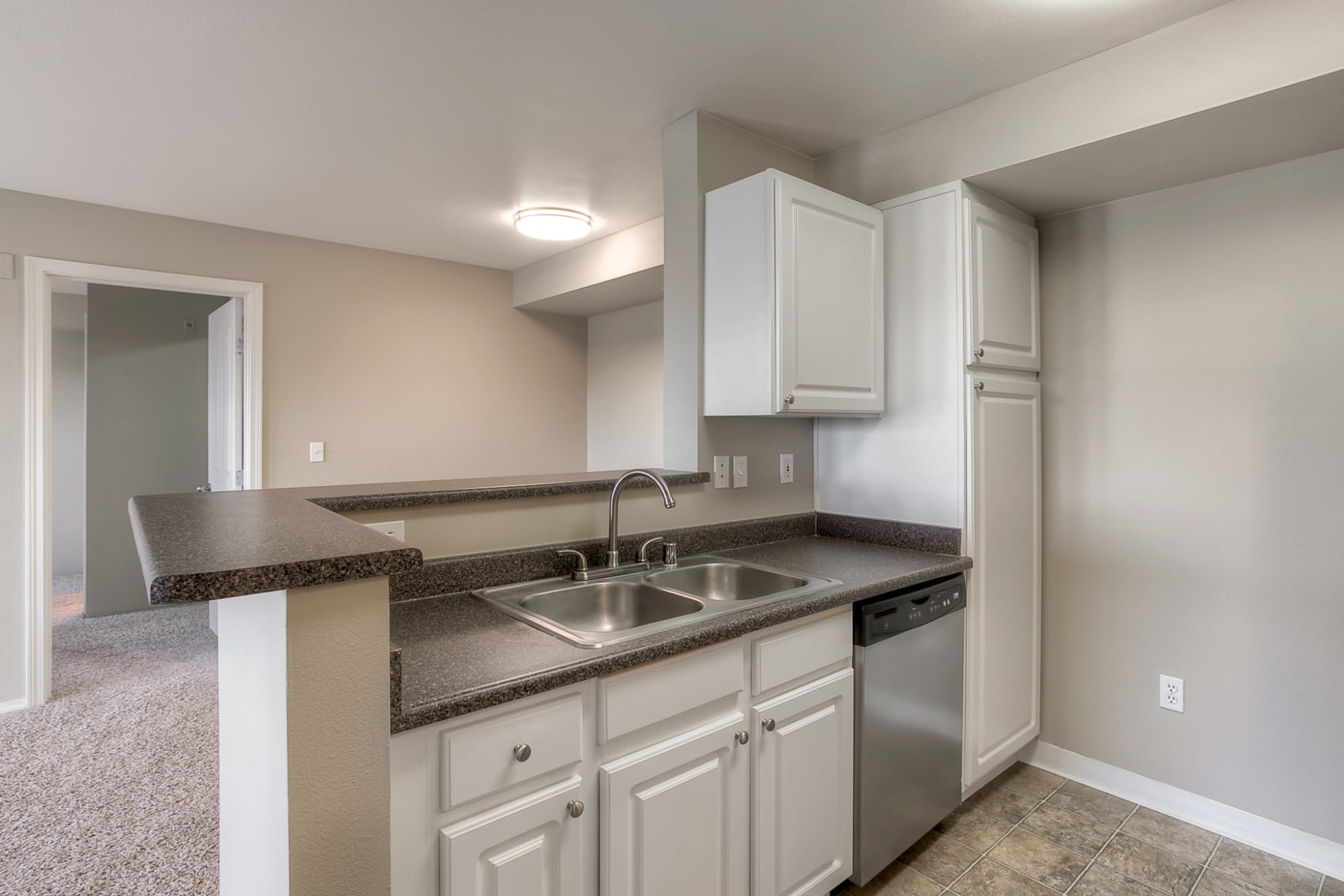 Kitchen, open floor plan at Pebble Cove Apartments in Renton