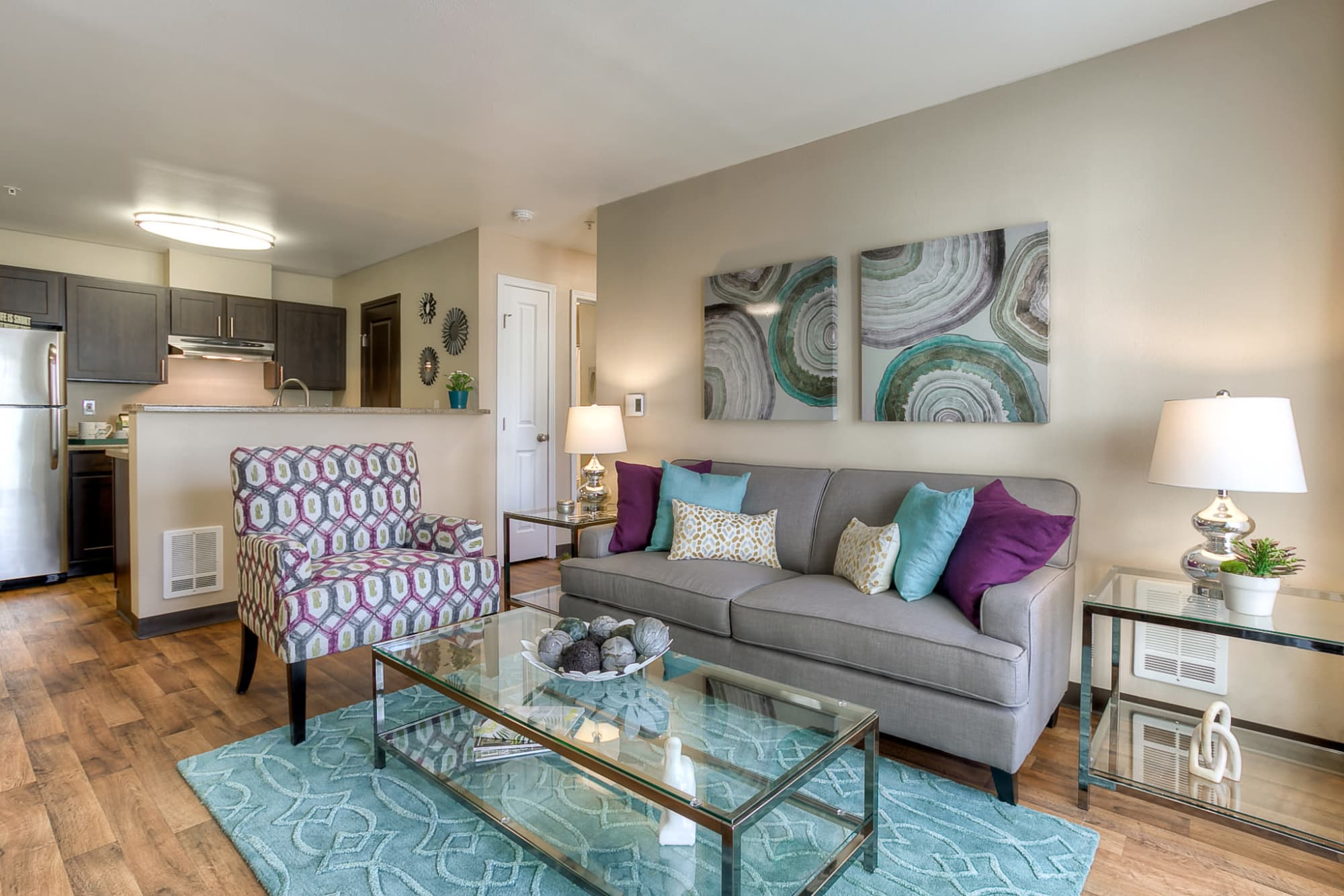 Living Room Area Fully Furnished Model at Pebble Cove Apartments in Renton