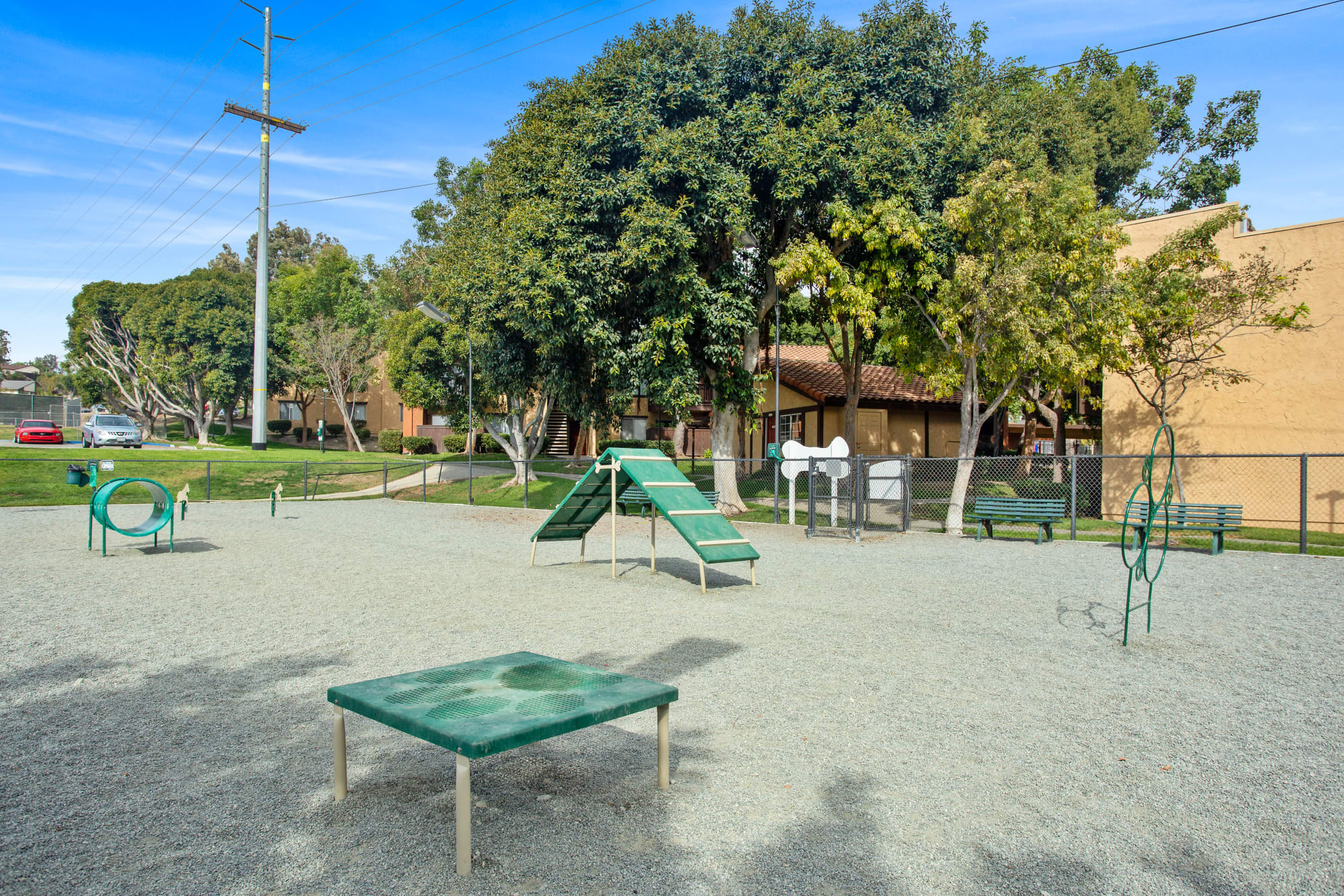 Large off-leash dog park with toys at Shadow Ridge Apartments in Oceanside, California