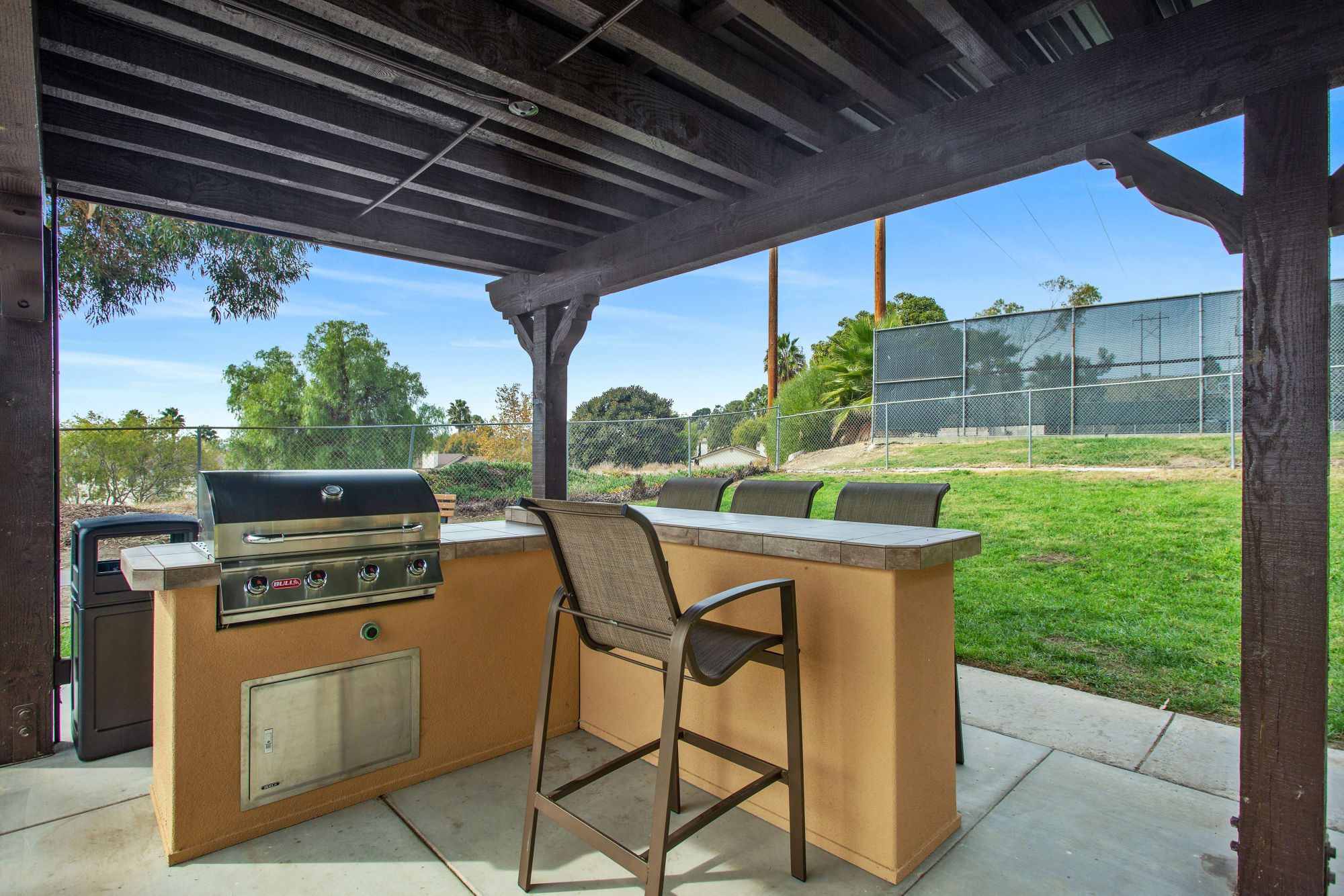 Covered BBQ area with bar top seating at Shadow Ridge Apartments in Oceanside, California