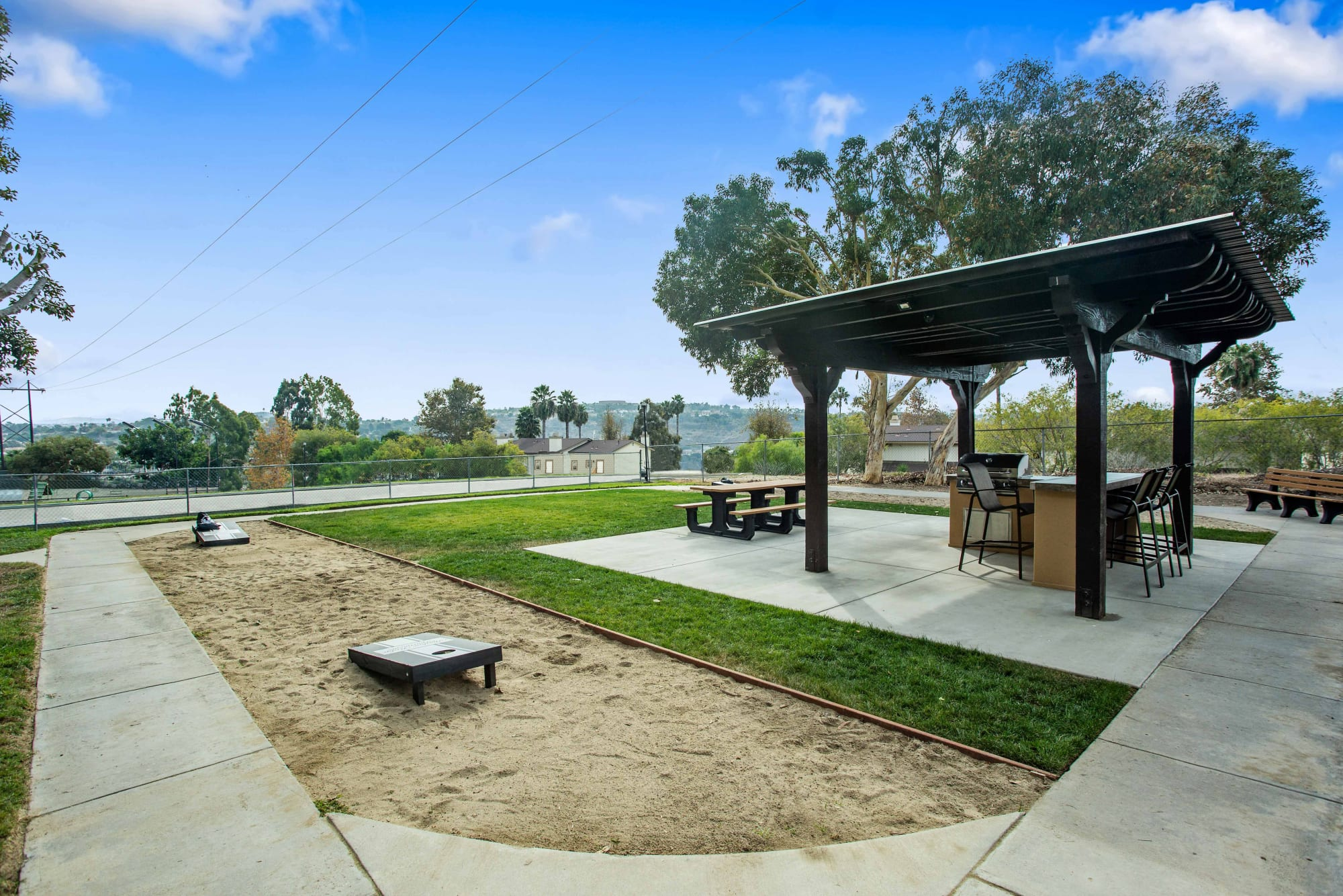 Corn hole, covered grills, and a picnic area at Shadow Ridge Apartments in Oceanside, California