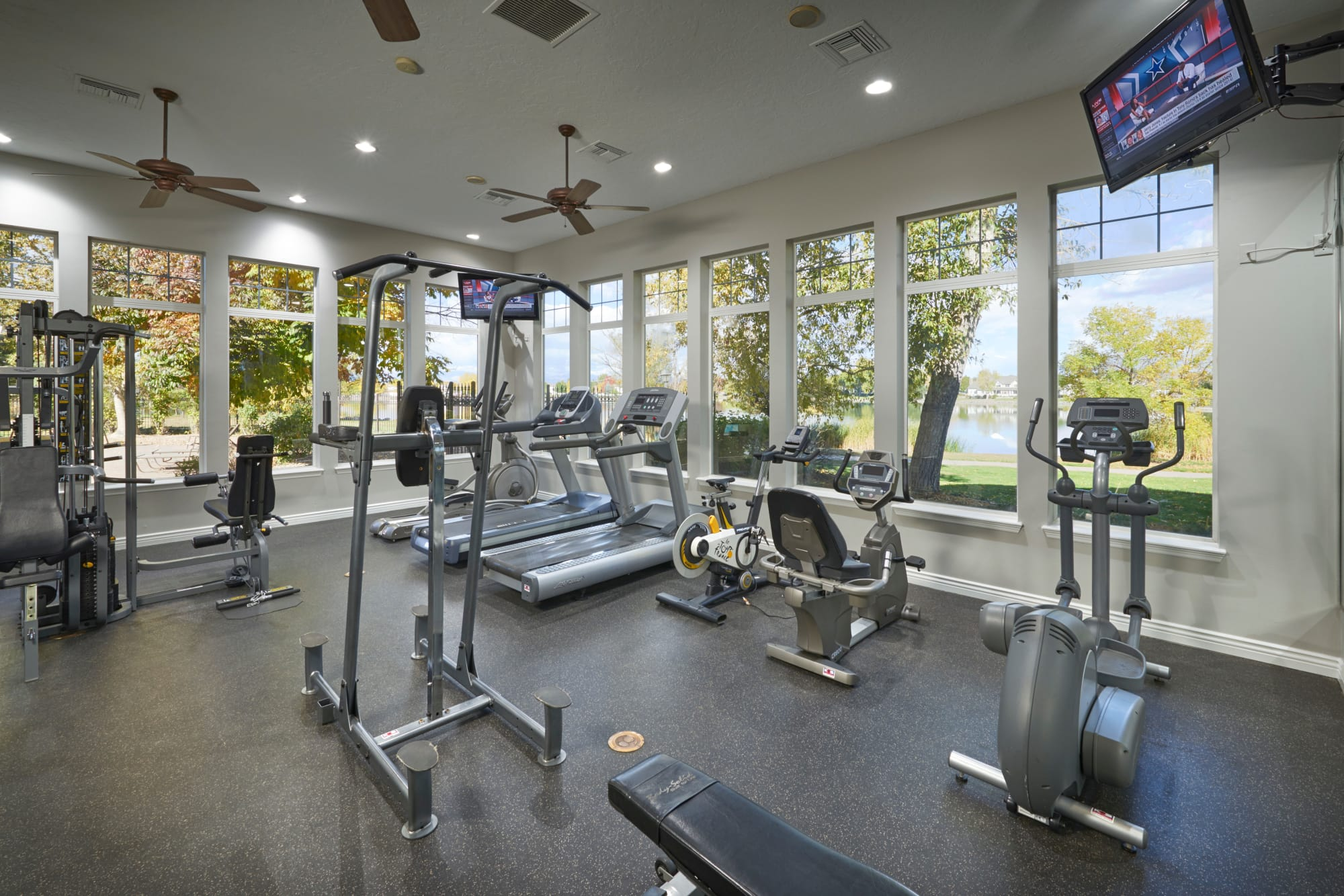 Fully equipped fitness center with lake views
