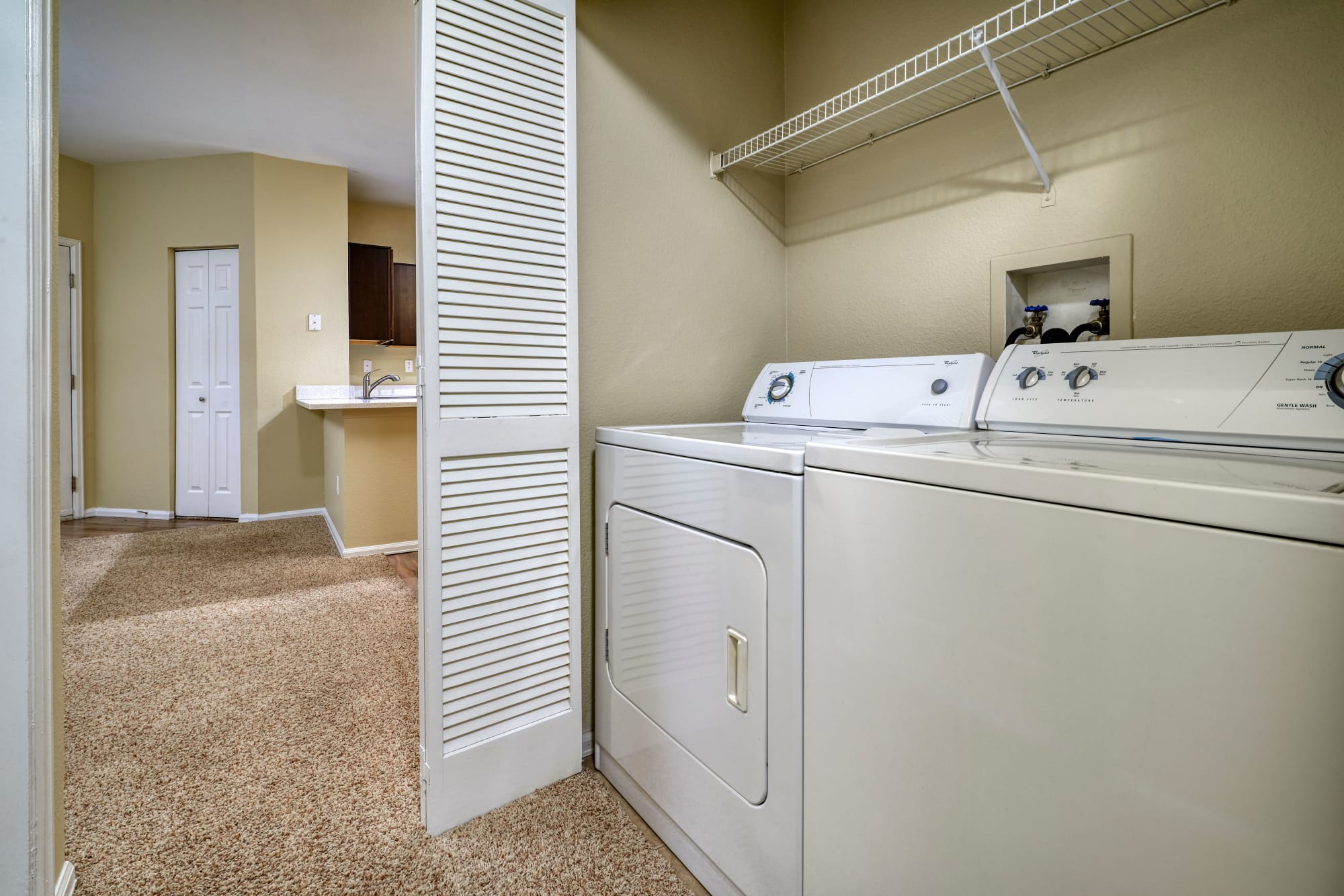 Washer and dryer at The Crossings at Bear Creek Apartments in Lakewood, Colorado