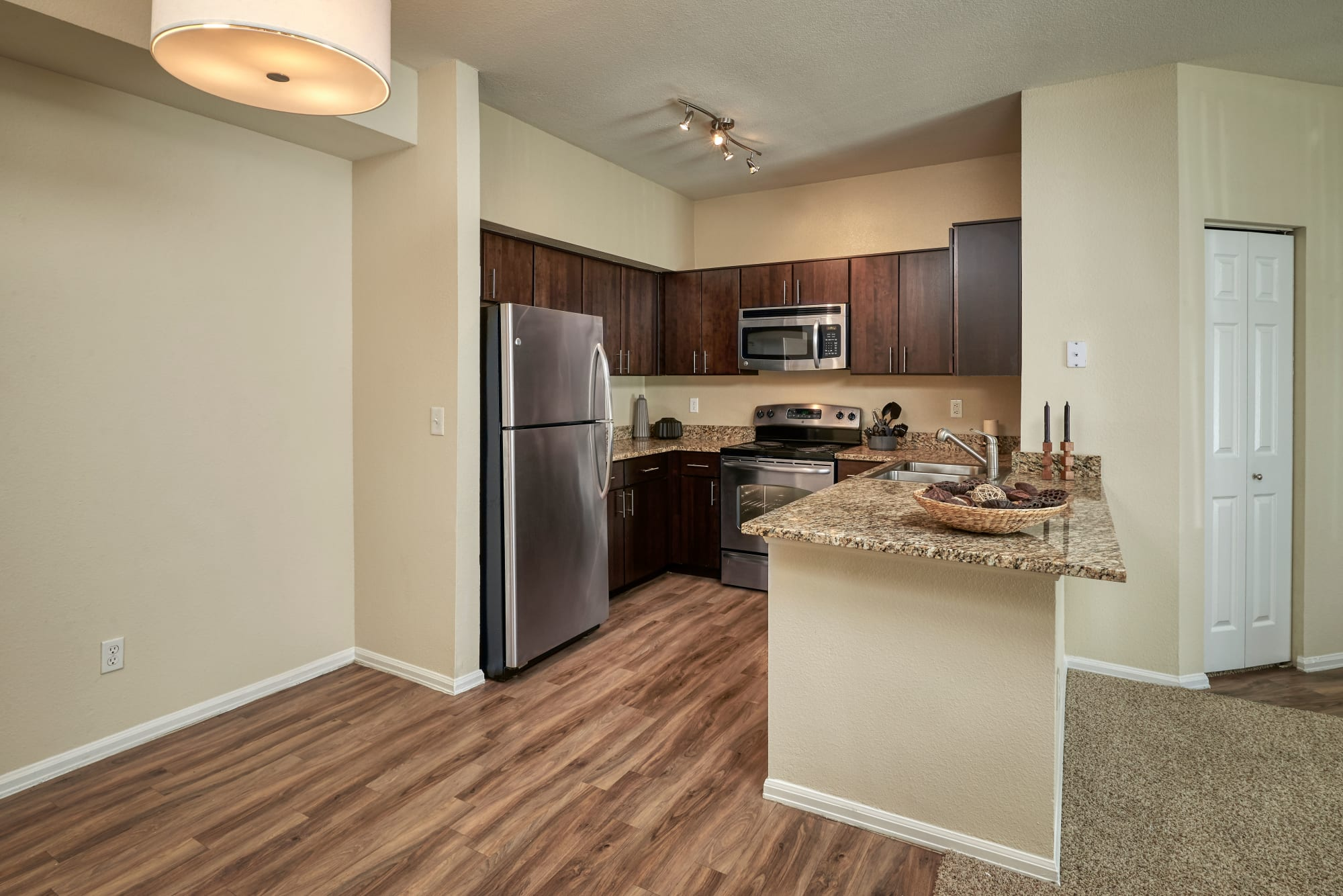 brown renovated kitchen with dining room view