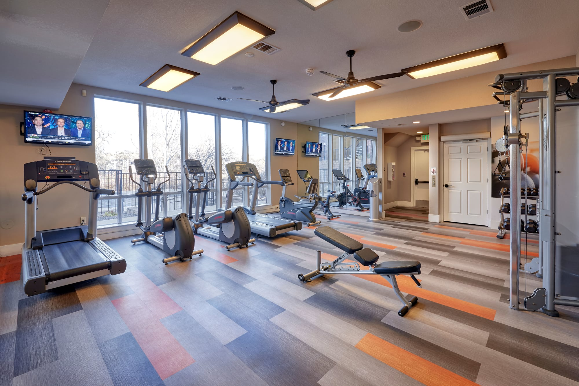 The newly renovated fitness center at The Crossings at Bear Creek Apartments in Lakewood, Colorado