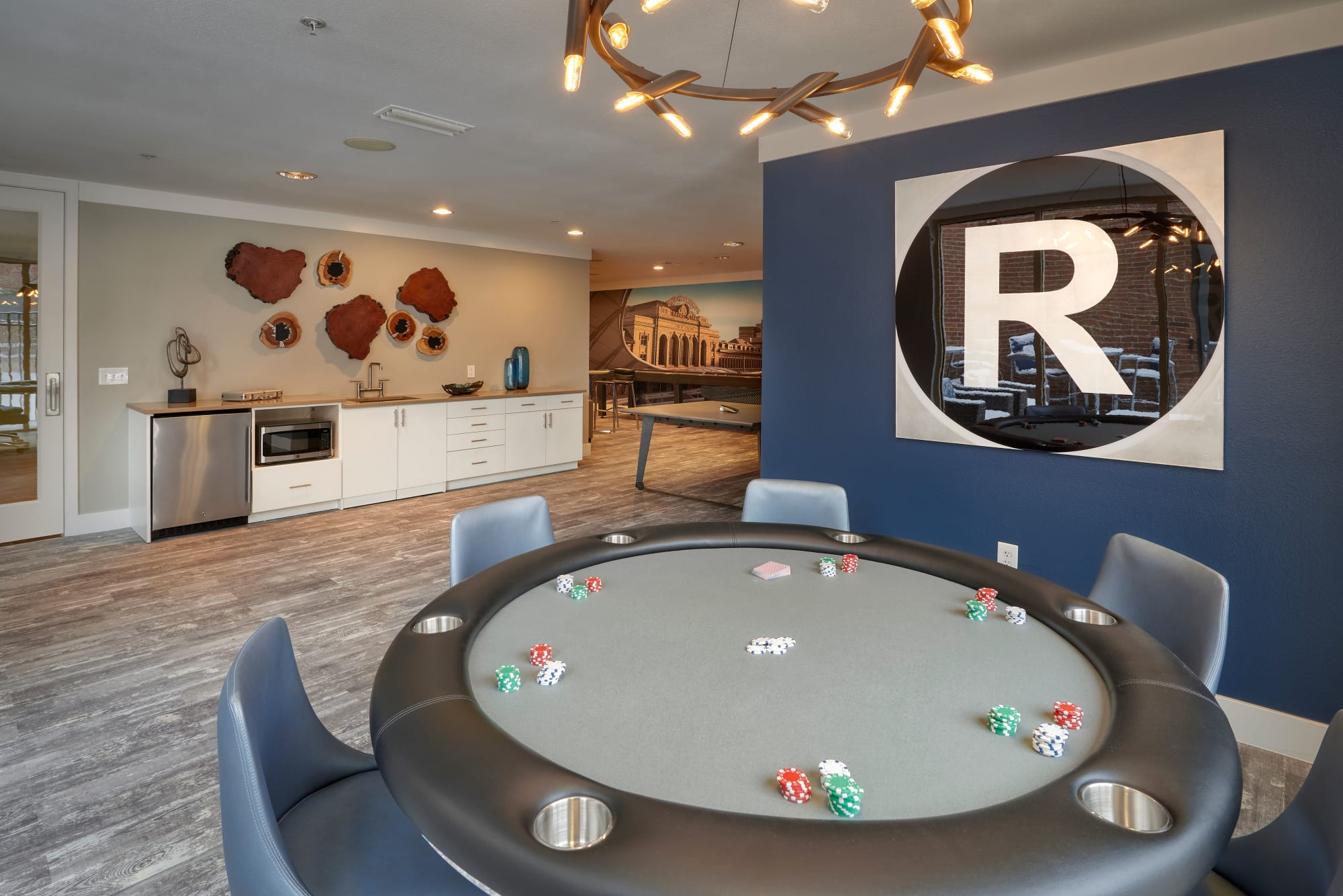 A clubhouse that is great for entertaining including a game room with a poker table at The Rail at Inverness in Englewood, Colorado