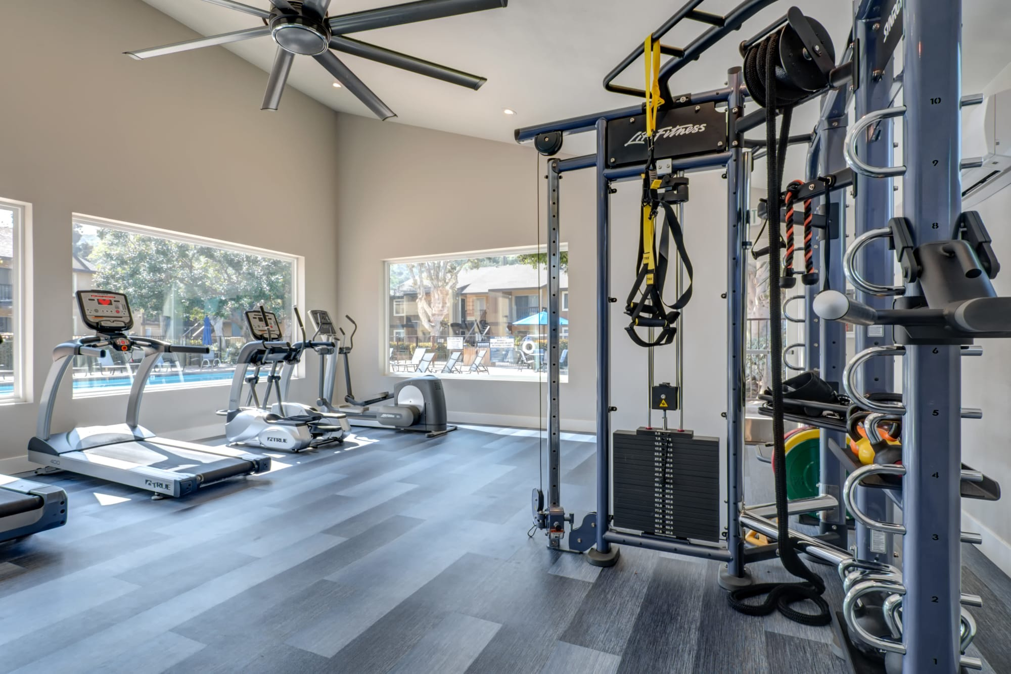fitness center with view of the pool area with large windows at Terra Nova Villas in Chula Vista, CA