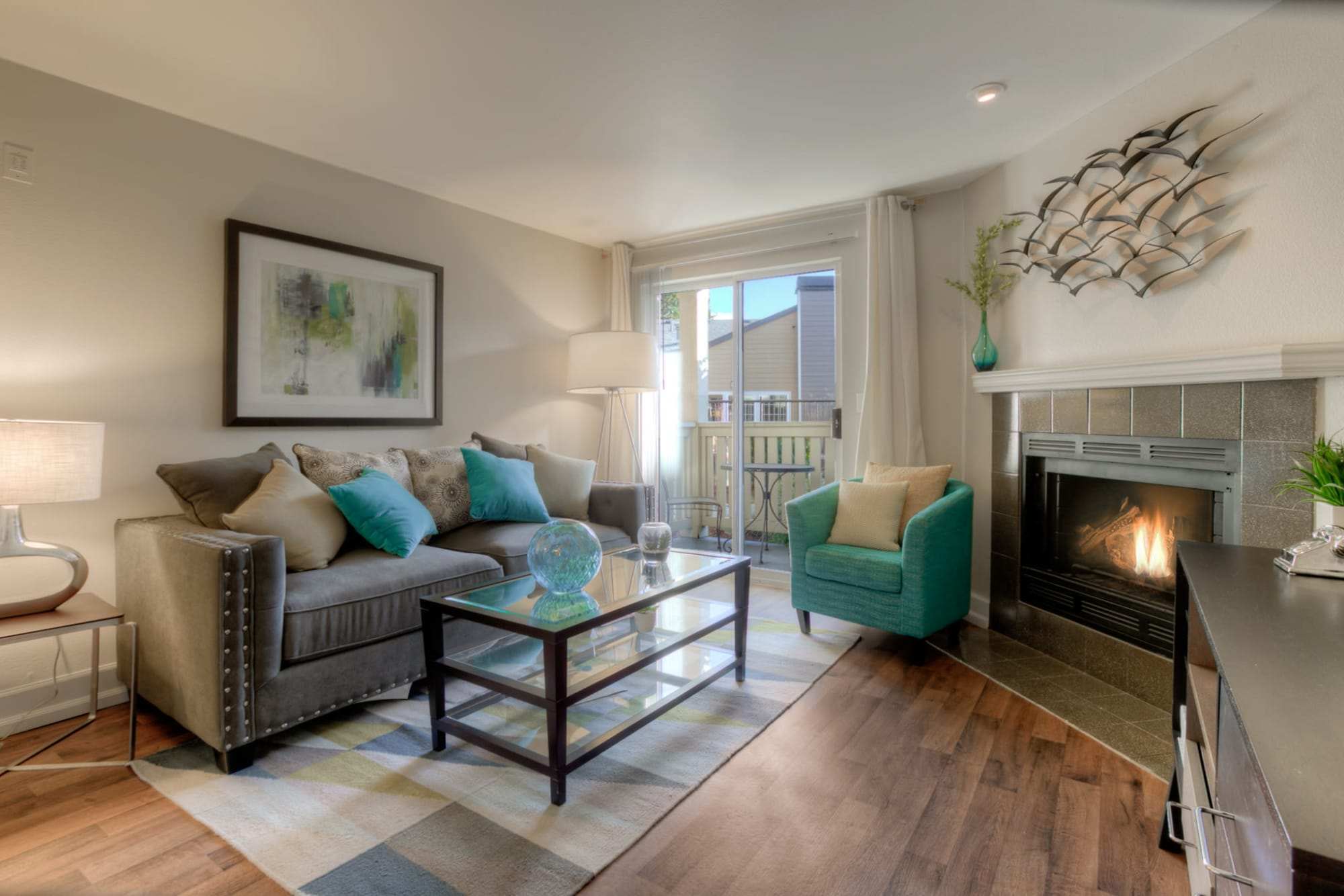 Living room with fireplace - model home at Newport Crossing Apartments