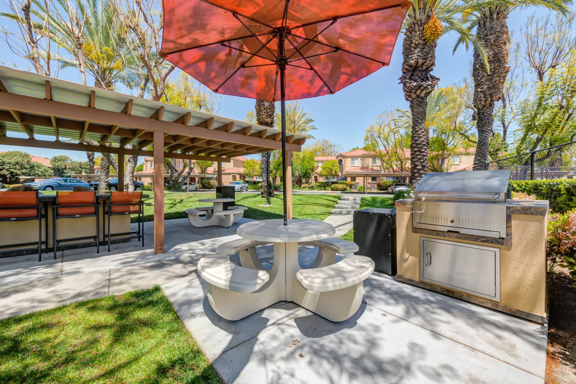 Outdoor Bbq/picnic area At Tuscany Village Apartments