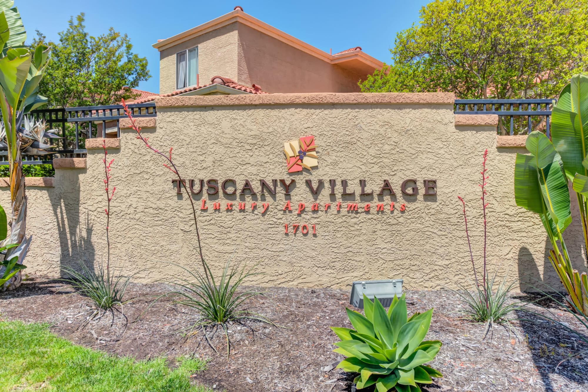 Monument Sign at entrance to property At Tuscany Village Apartments