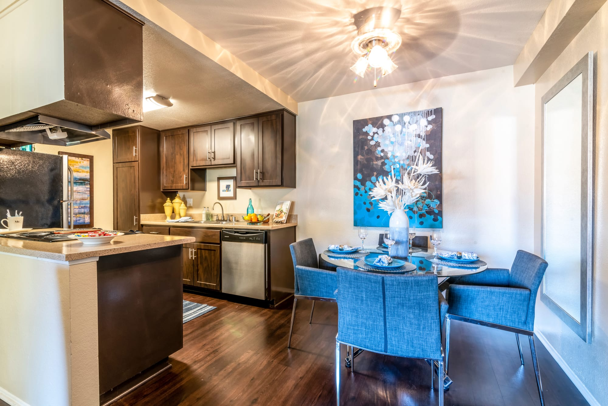 Well Decorated Apartment Interior, Renovated brown spec kitchen and dining room area at Terra Nova Villas in Chula Vista, CA