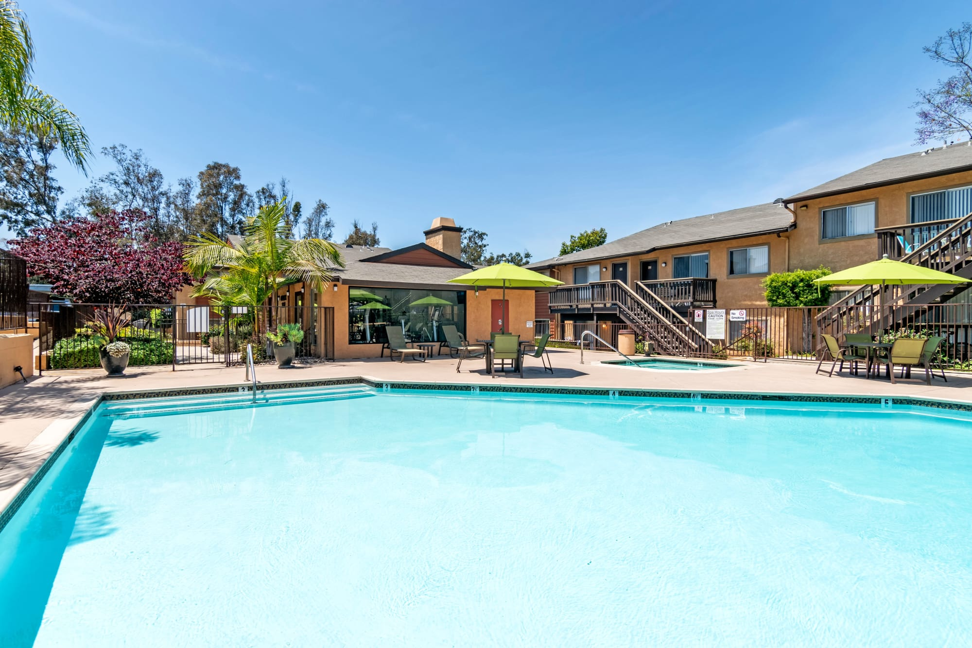 The sparkling swimming pool on a sunny day at Hillside Terrace Apartments in Lemon Grove, California