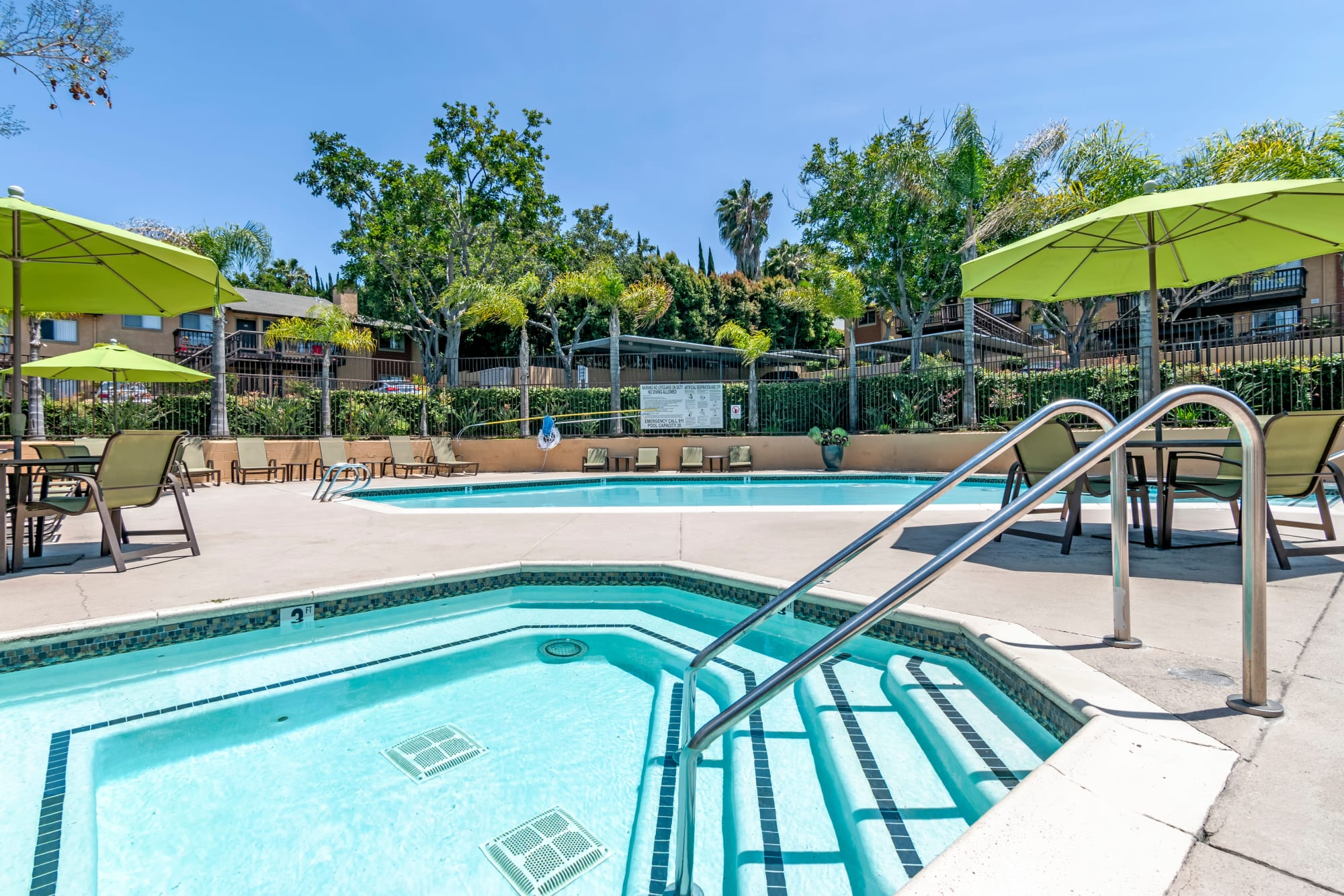 The spa, pool and poolside cabanas at Hillside Terrace Apartments in Lemon Grove, California