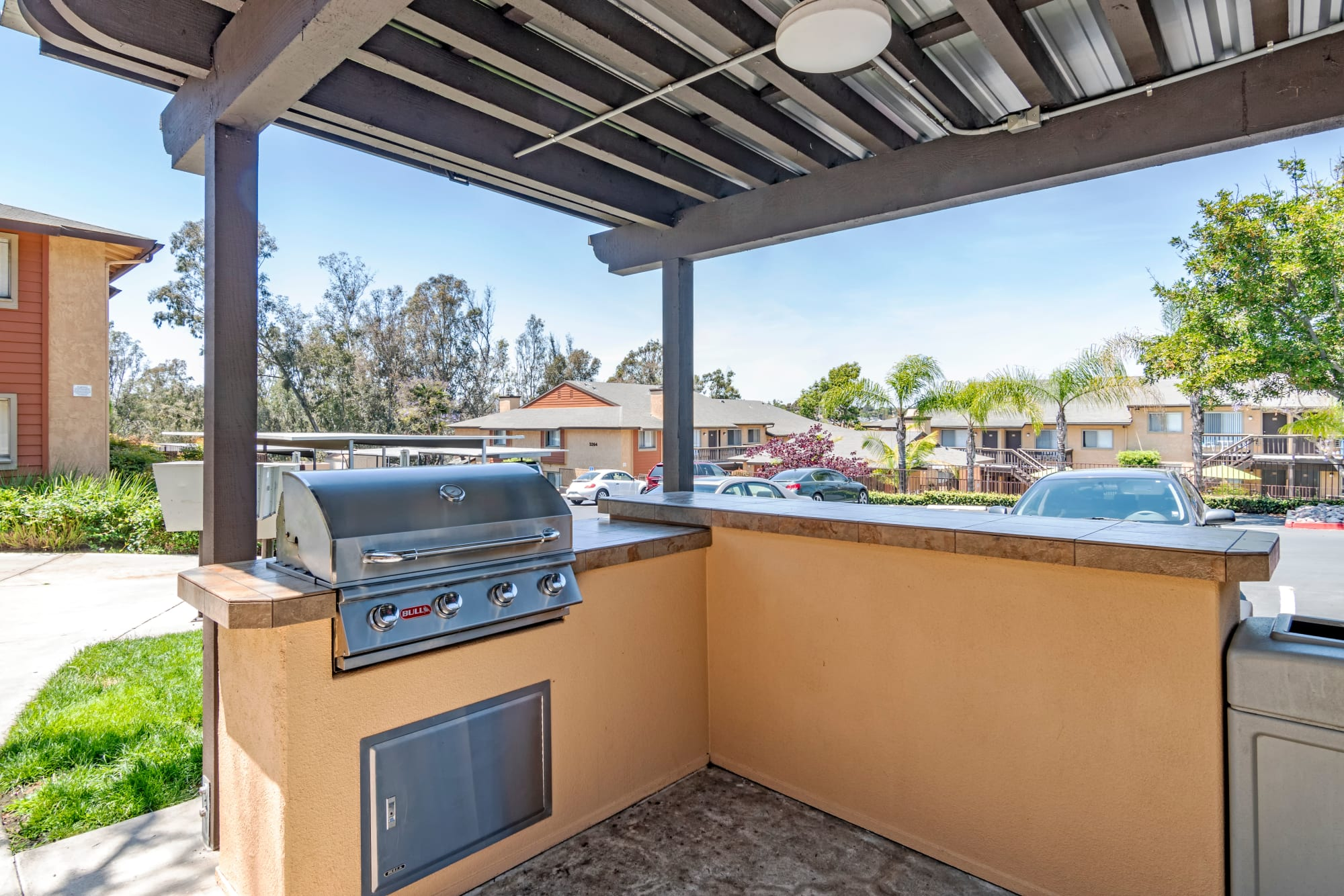 Covered outdoor BBQ area at Hillside Terrace Apartments in Lemon Grove, California